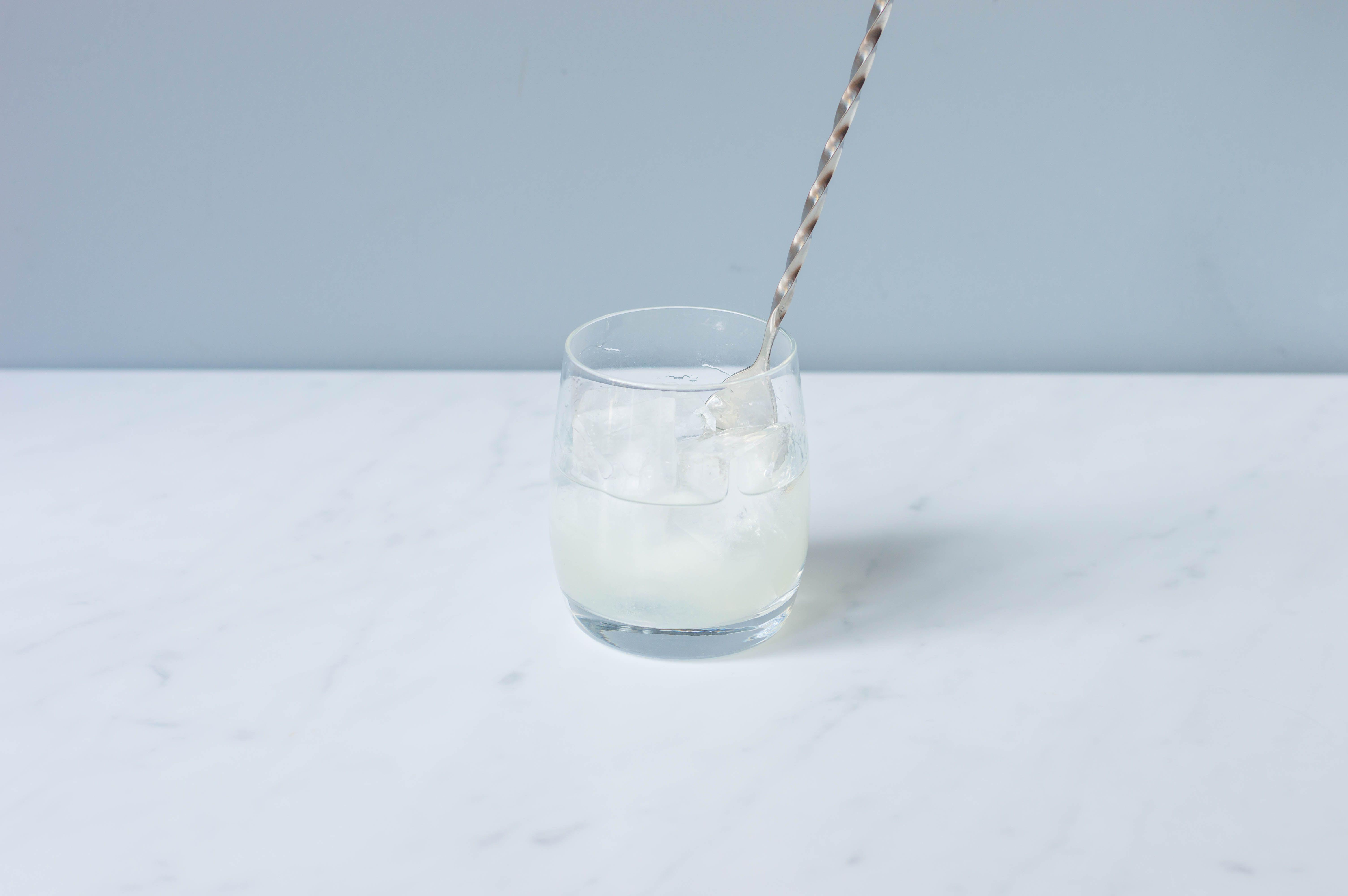 Foghorn cocktail is stirred