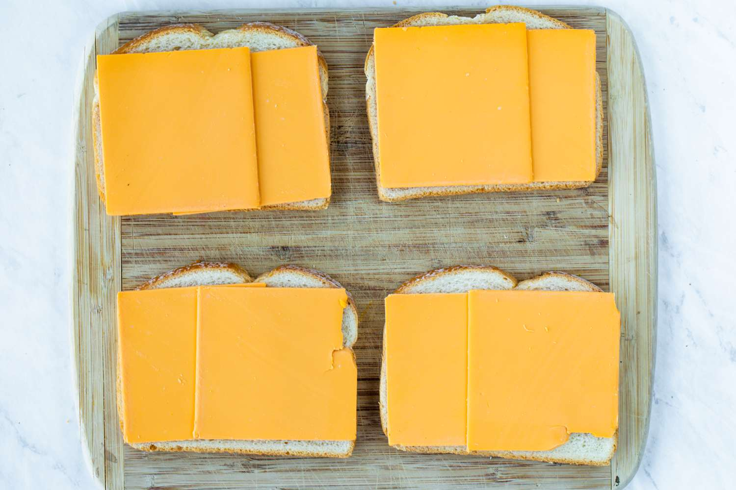 Place dairy-free cheese on top of four of the bread slices