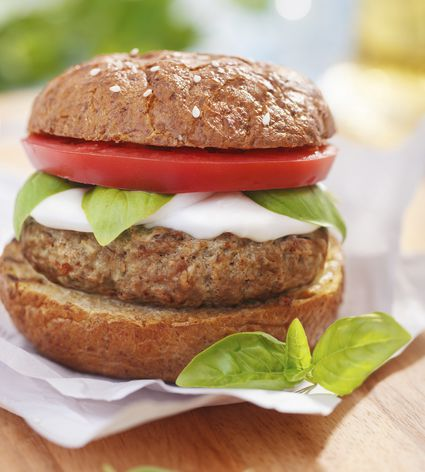 Italian style burger with mozzarella cheese, basil and tomatoes