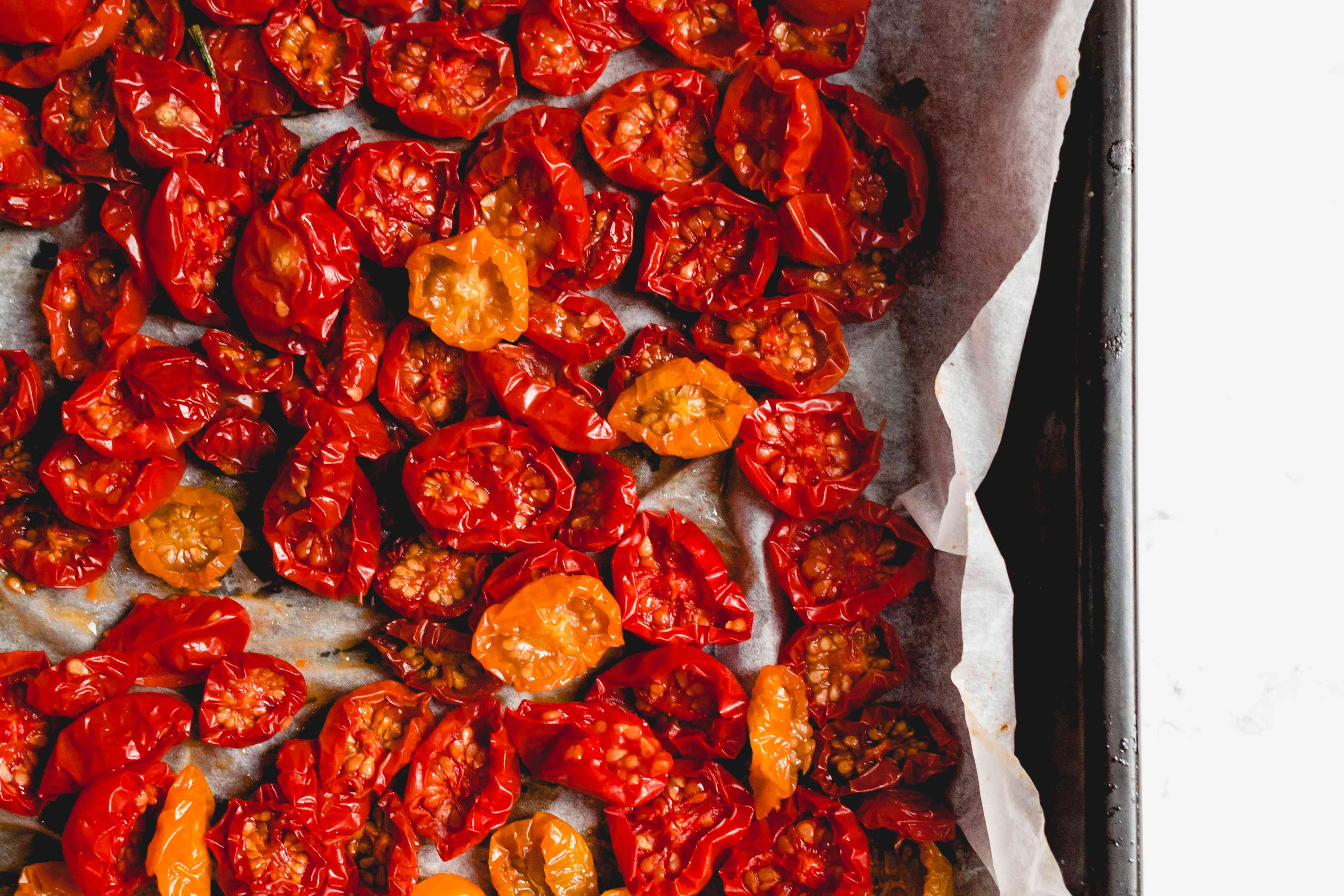 Oven-Dried Cherry Tomatoes on a parchment paper lined baking sheet