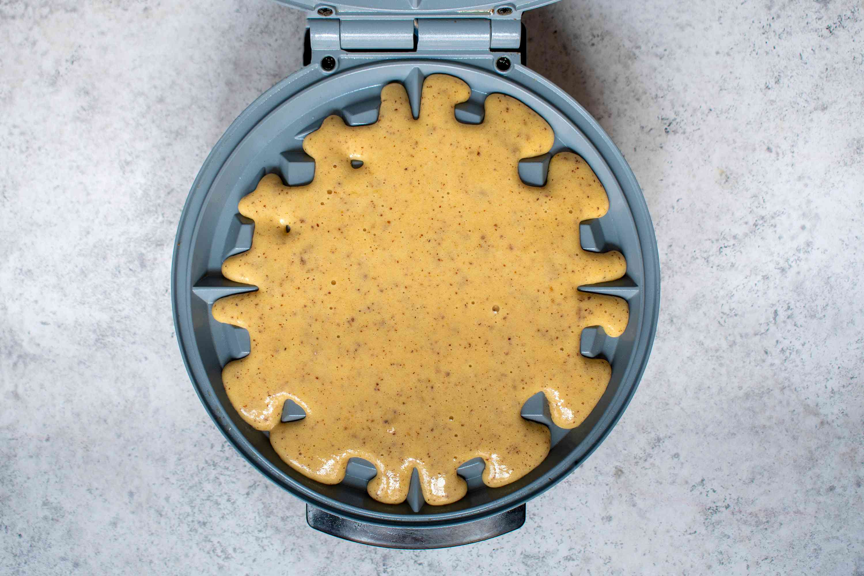 Keto waffle batter in waffle iron