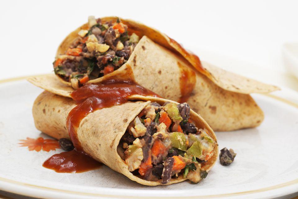 Close up of spicy black bean veggie burrito on plate