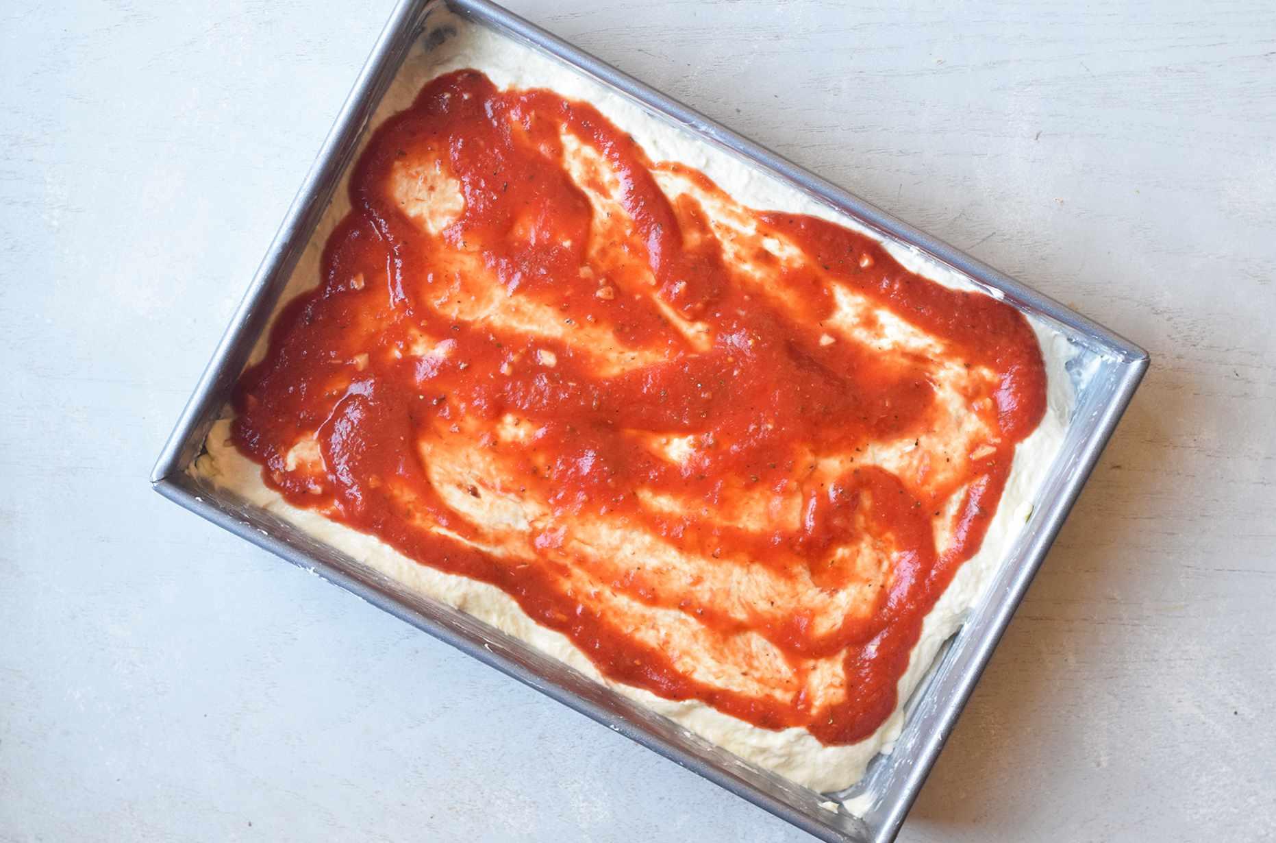 Pizza sauce on dough