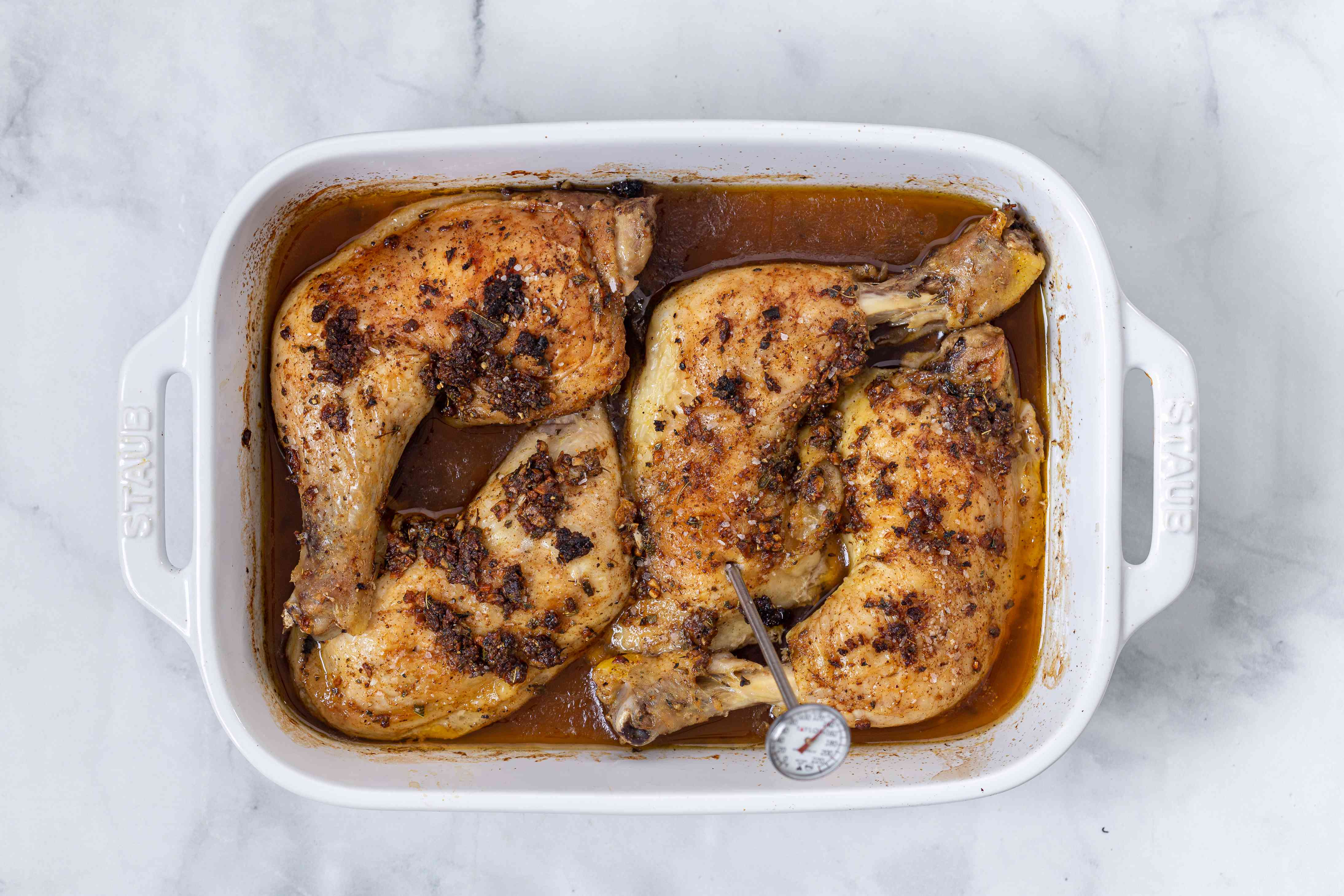 Baked chicken with a thermometer inserted