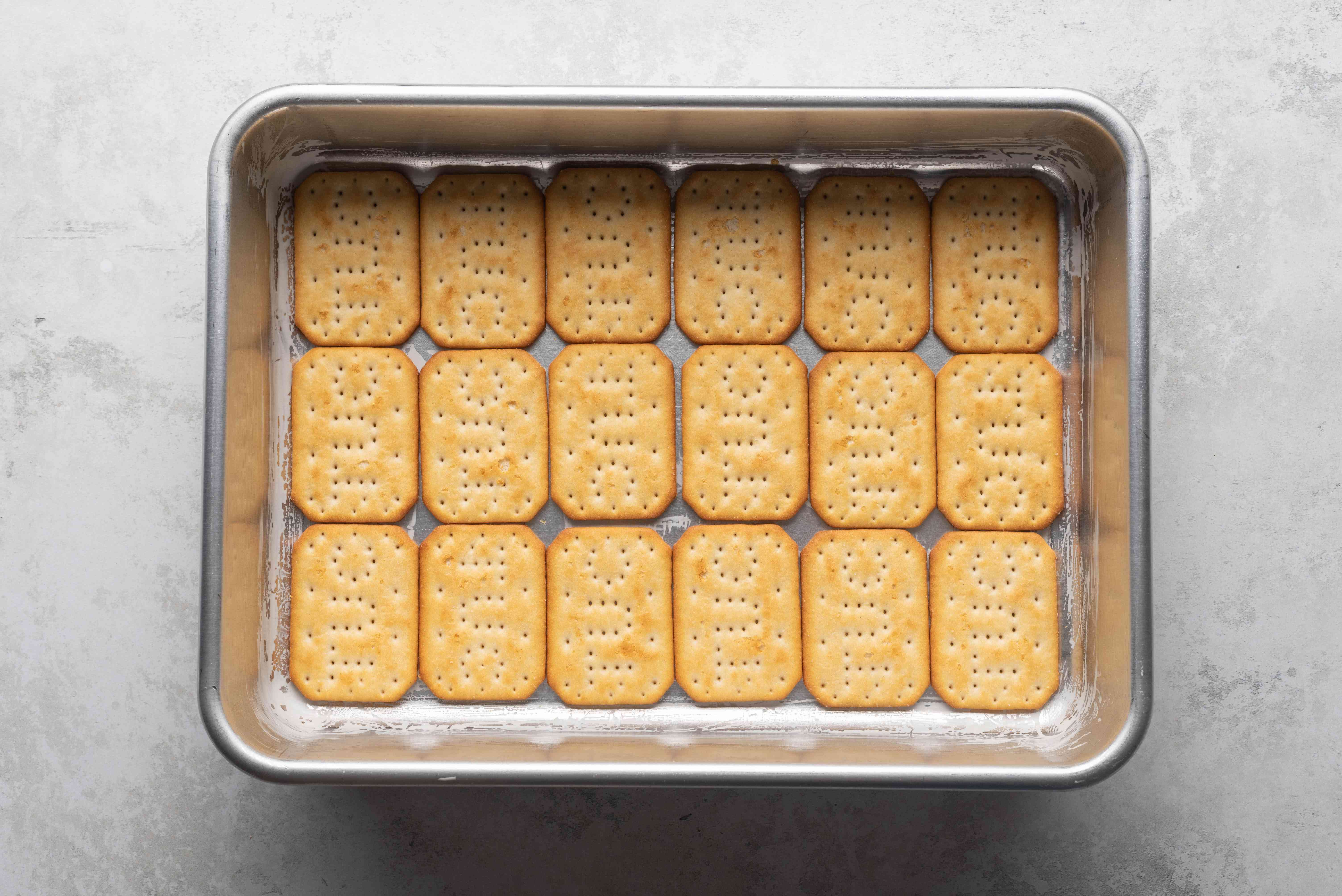 crackers and butter in a baking dish