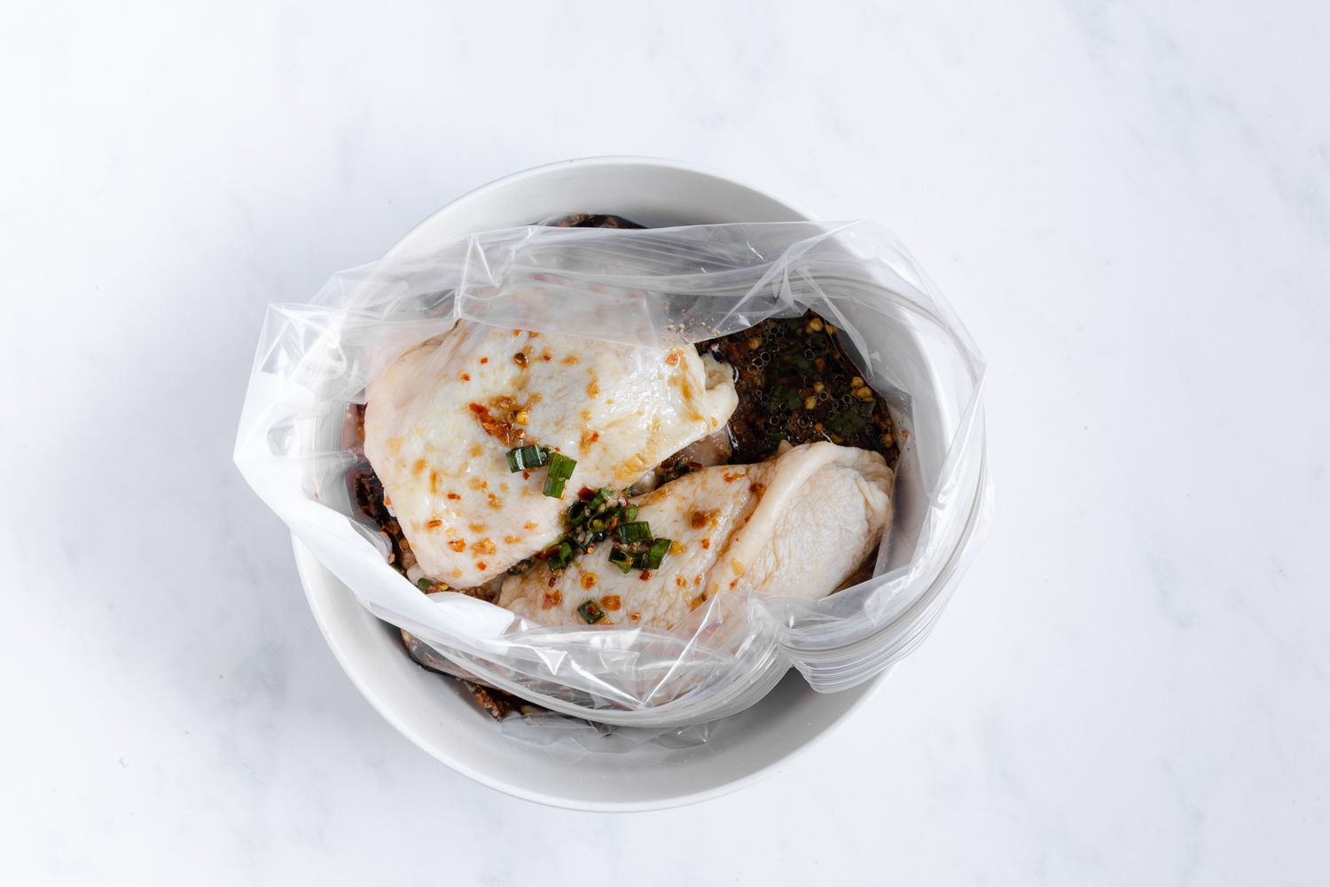 chicken and marinade in a bag