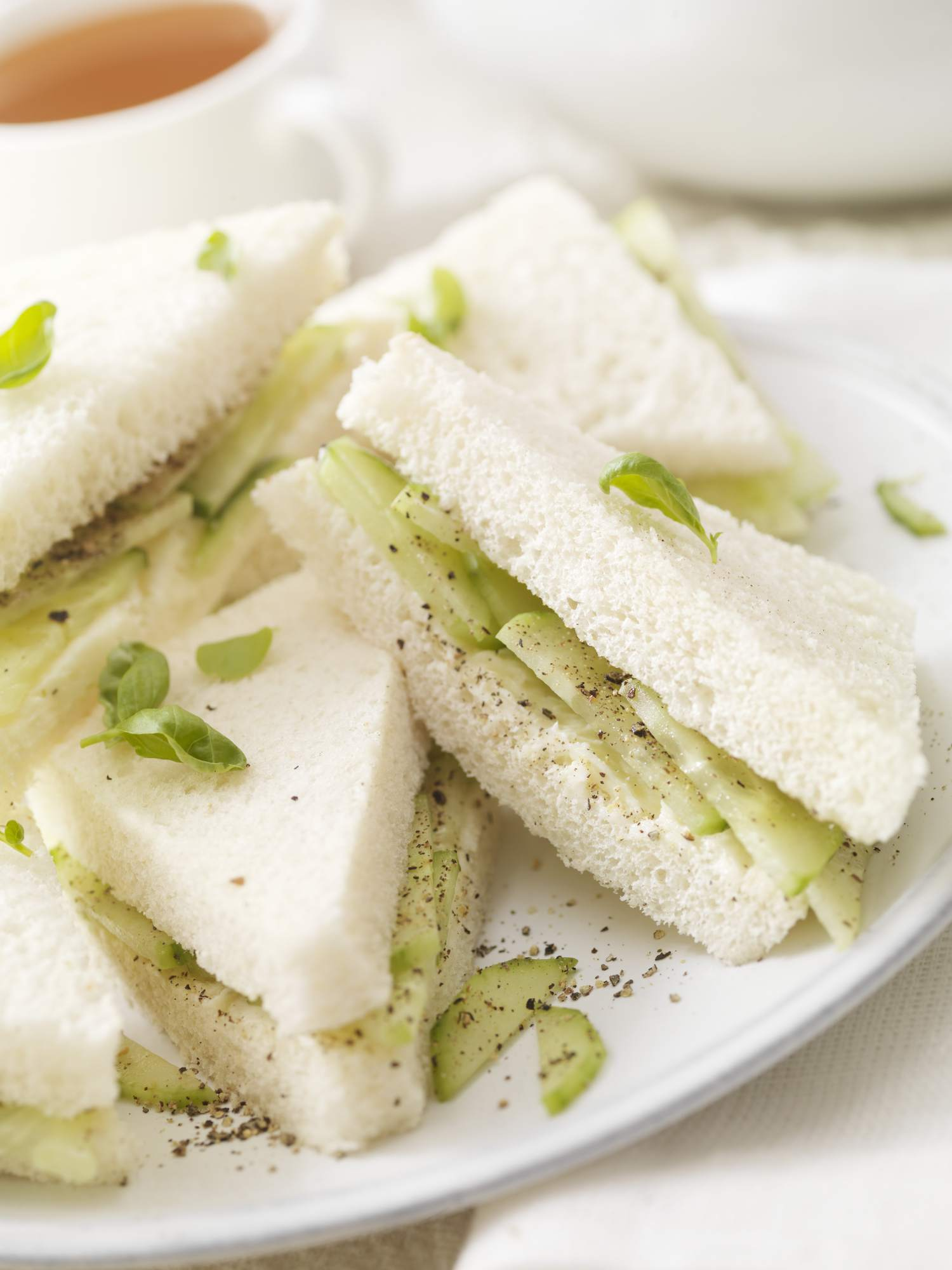 Crustless English cucumber sandwiches with butter, salt, pepper and fresh herbs