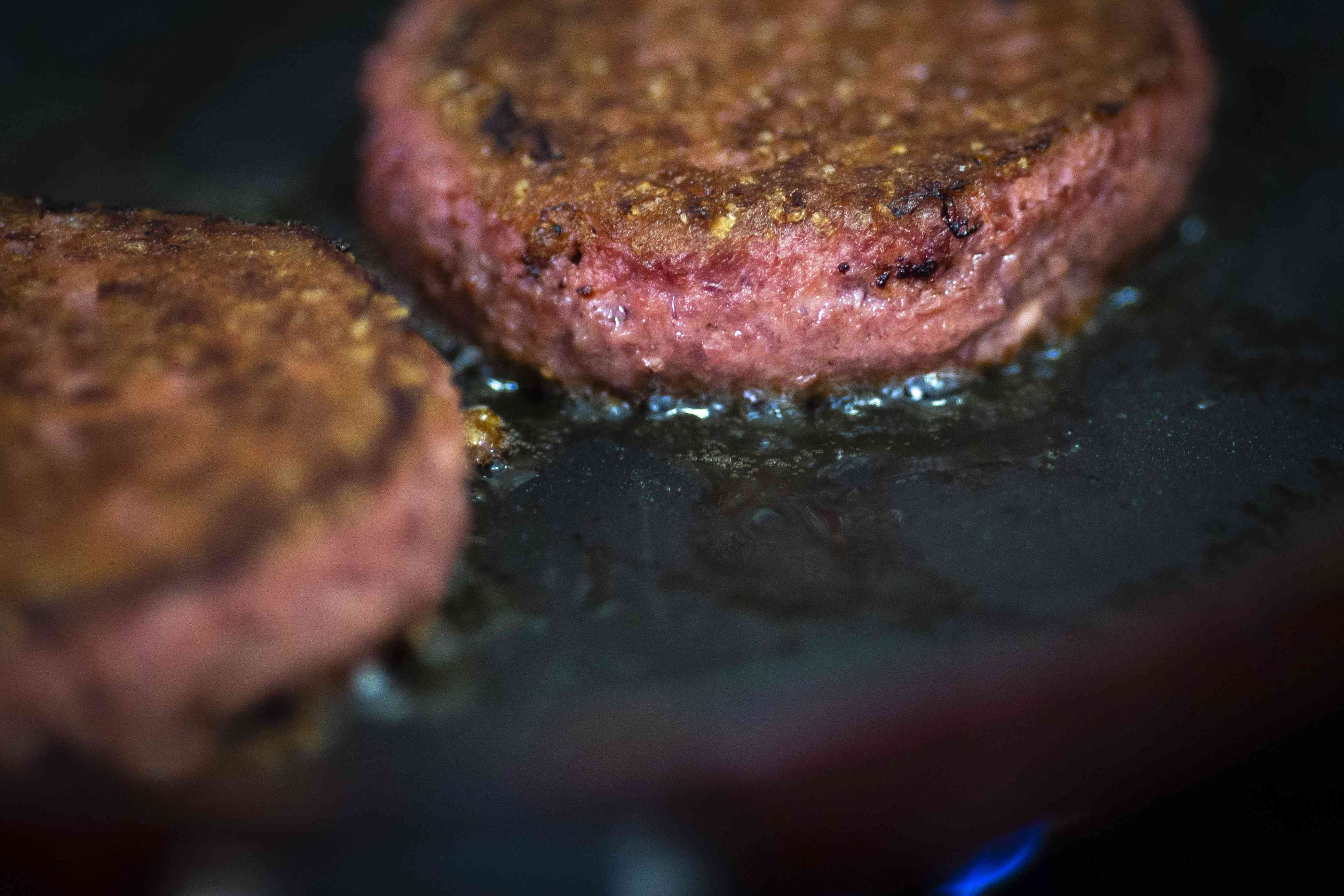 Beyond Meat burgers cooking
