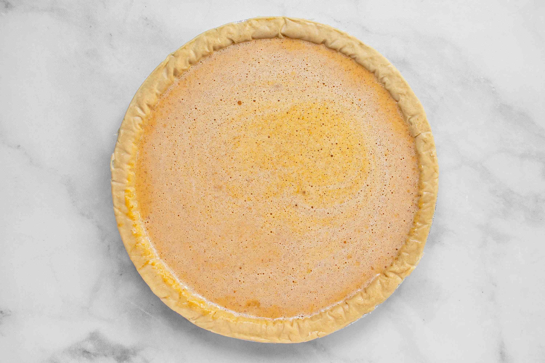 pour pumpkin pie filling mixture into the pie crust