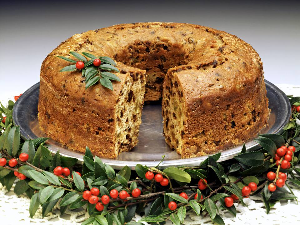 A fruitcake with slice cut out