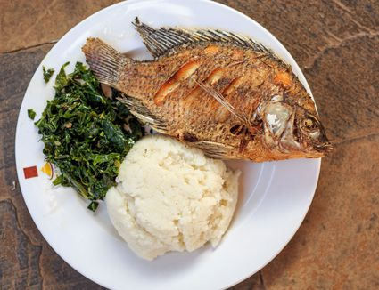 Ugali, Fish and Greens on a plate