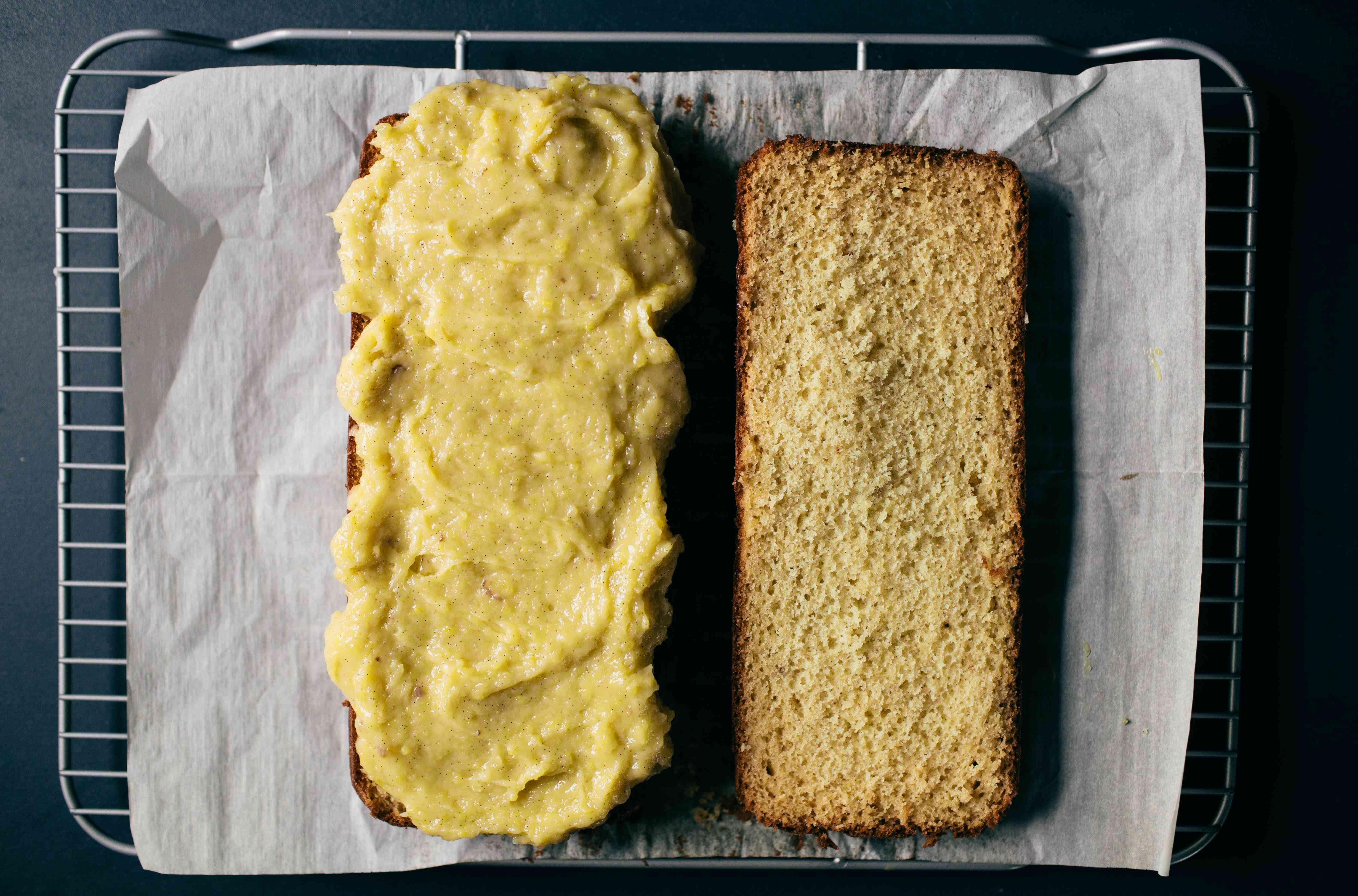 spready pastry cream on eclair cake halves