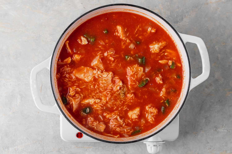 Arroz con Pollo ingredients in a pot