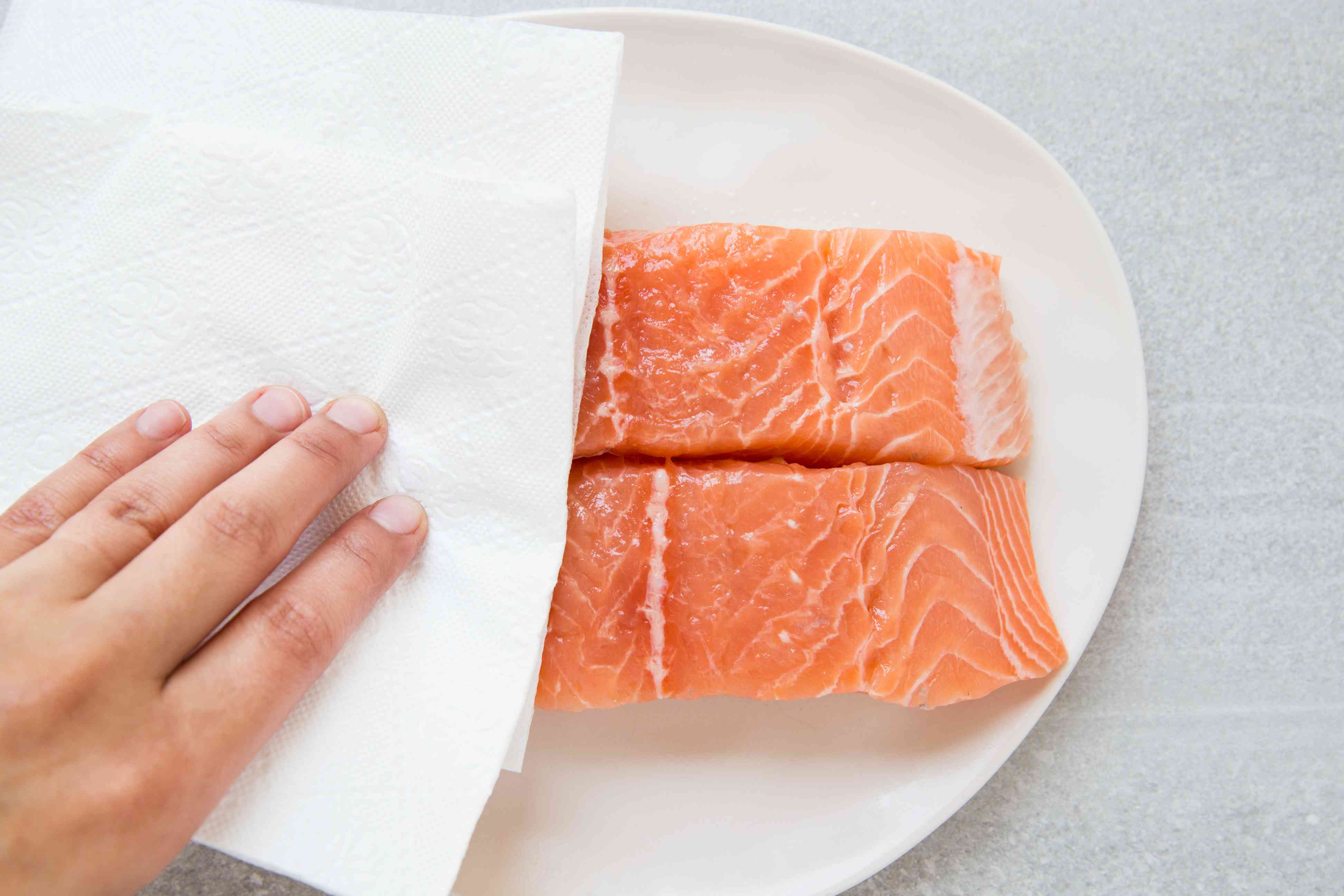 Pat the salmon fillets dry