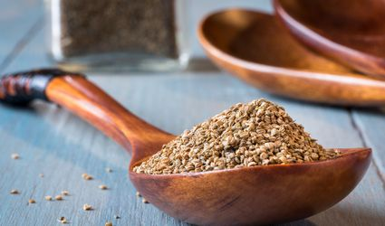 Whole celery seed in a wooden spoon