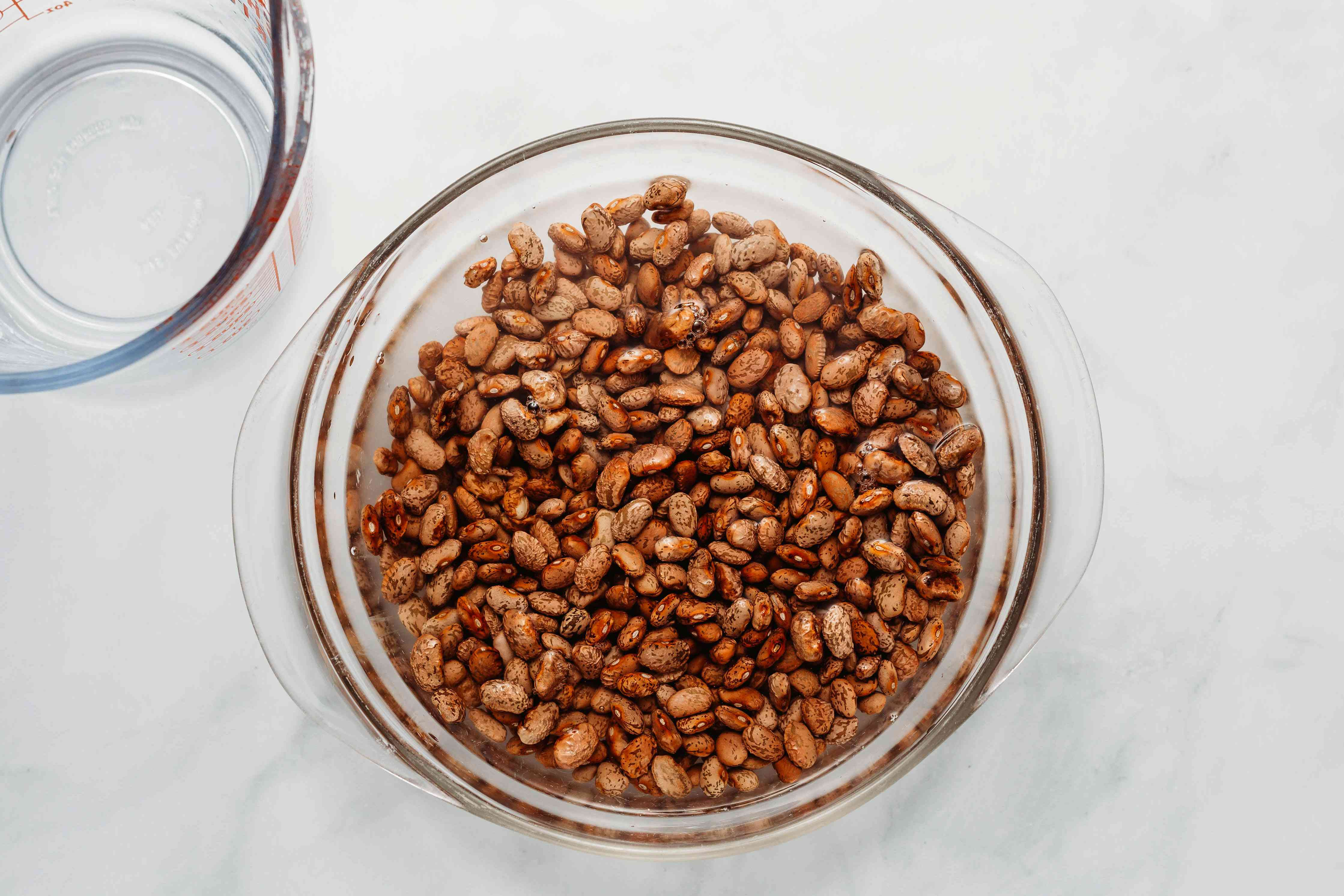 Soak the beans in water in a bowl