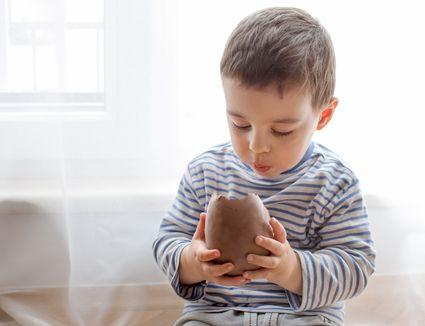 Boy eating chocolate easter egg