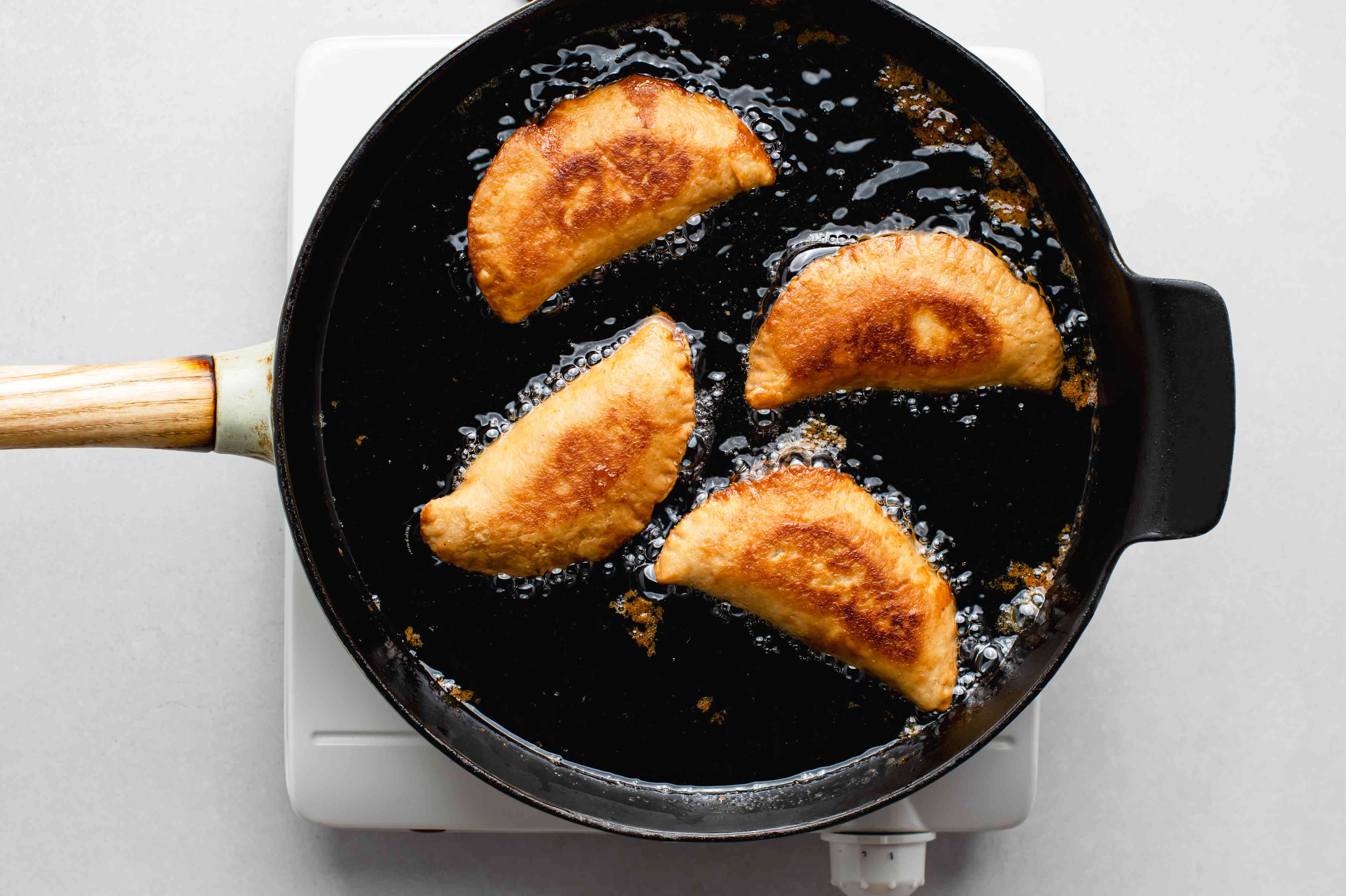 empanadas frying in oil