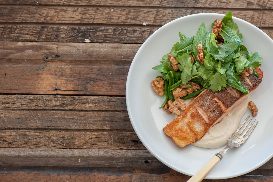 Crispy fish with tahini yogurt and herby walnut salad