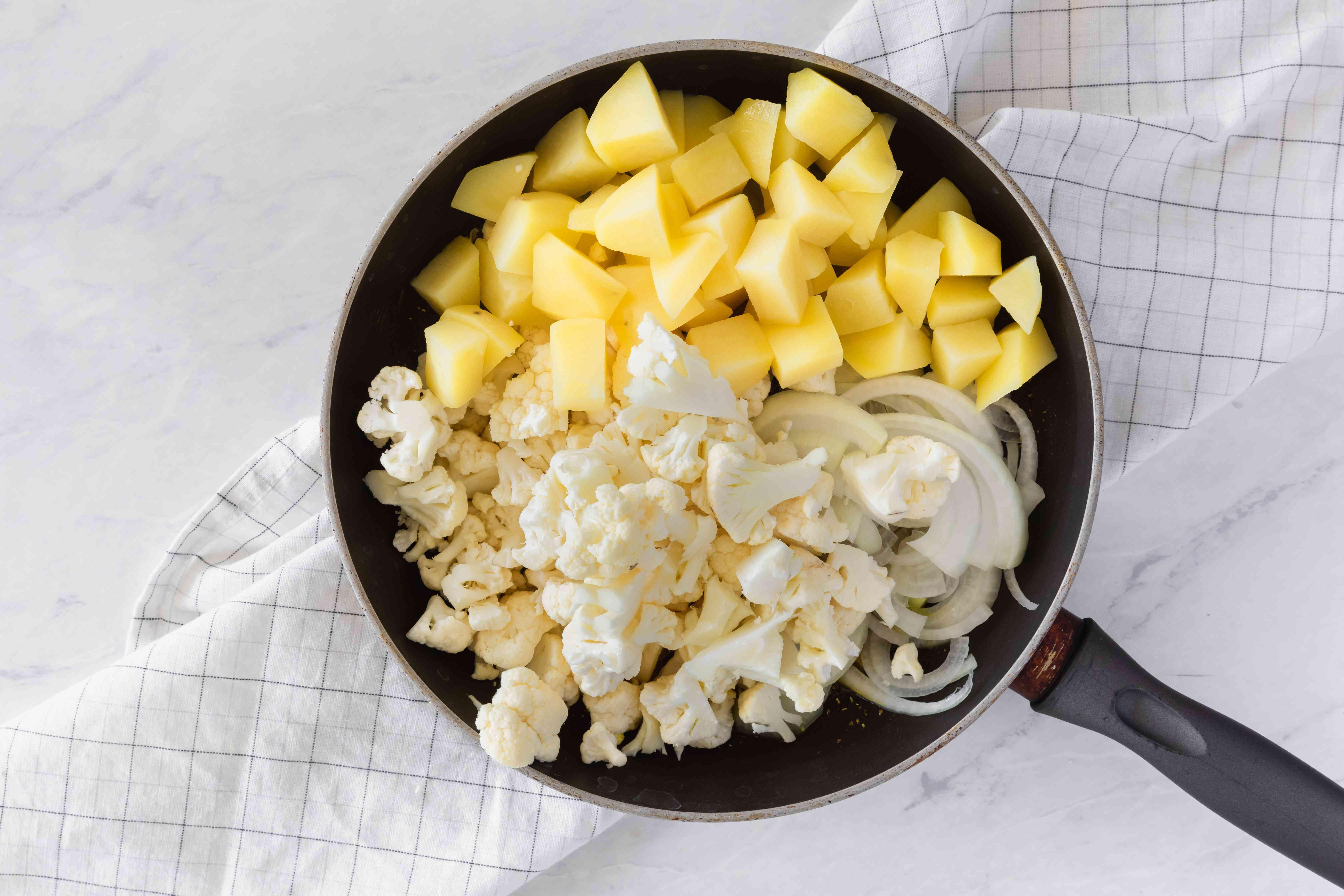 Add potatoes and cauliflower