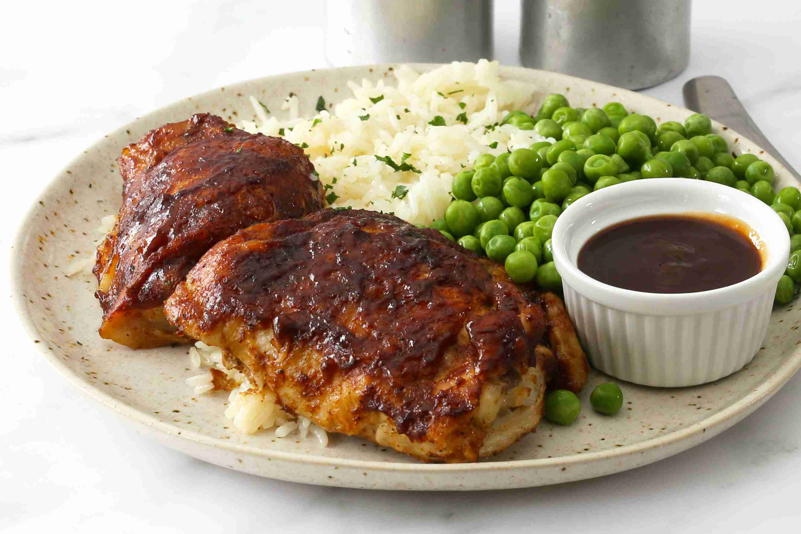 Instant Pot bbq chicken on a plate with rice.