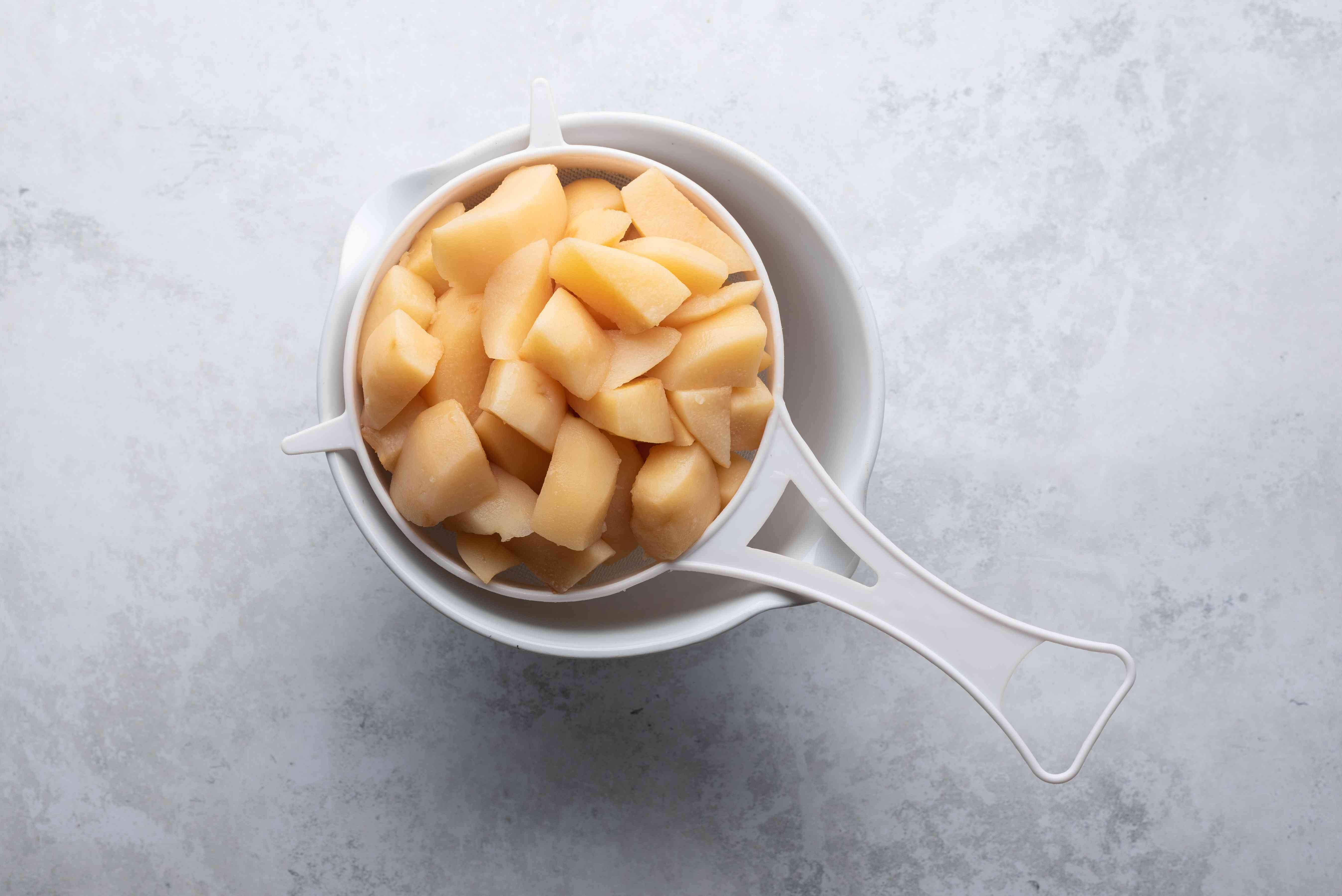quince in a colander