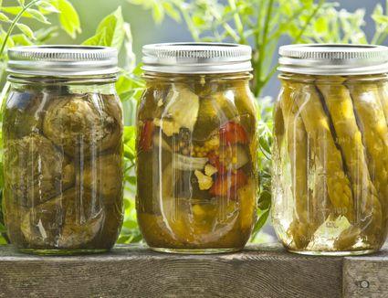 Homegrown pickled vegetables in jars