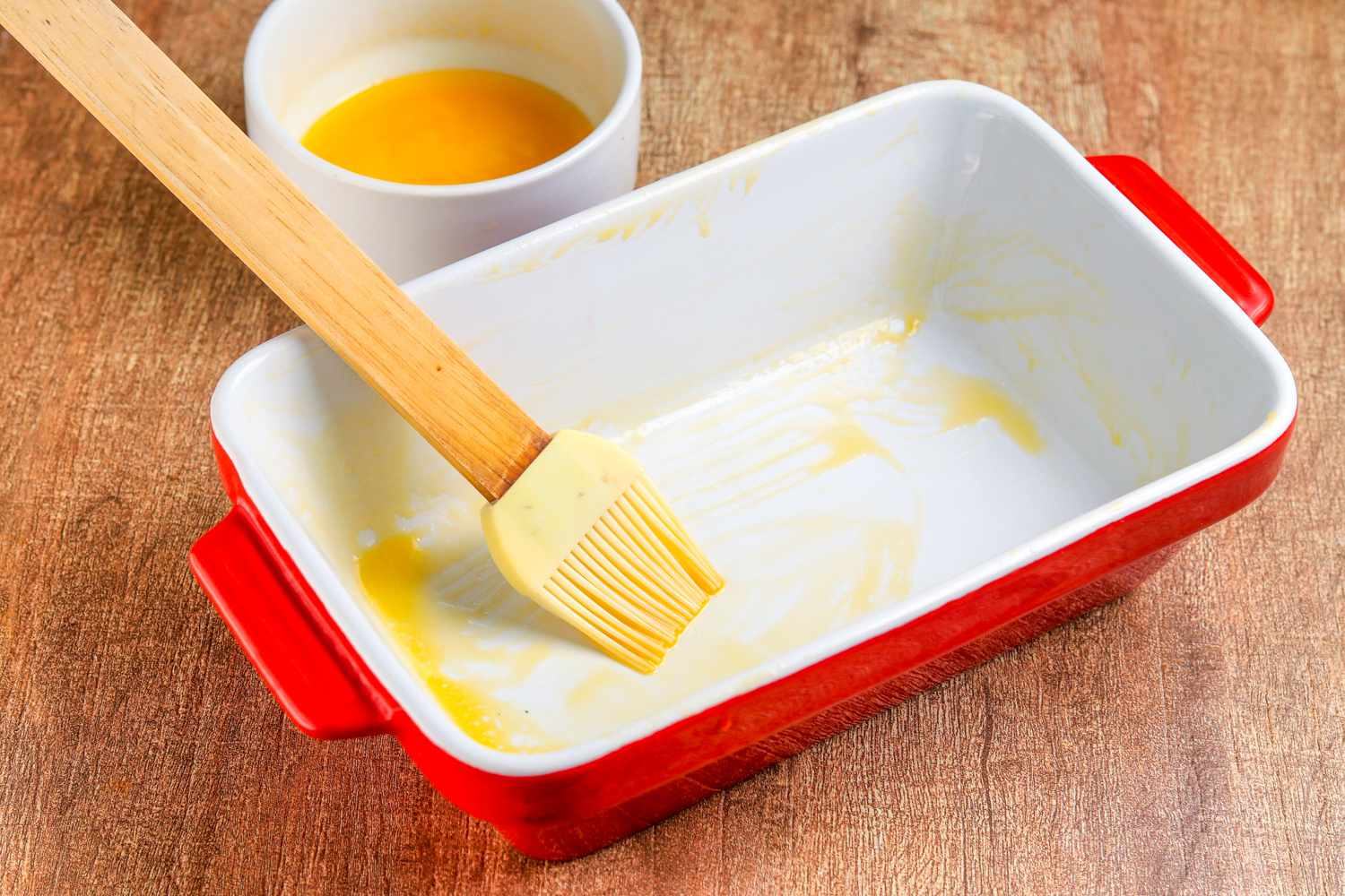 Buttered shallow baking dish