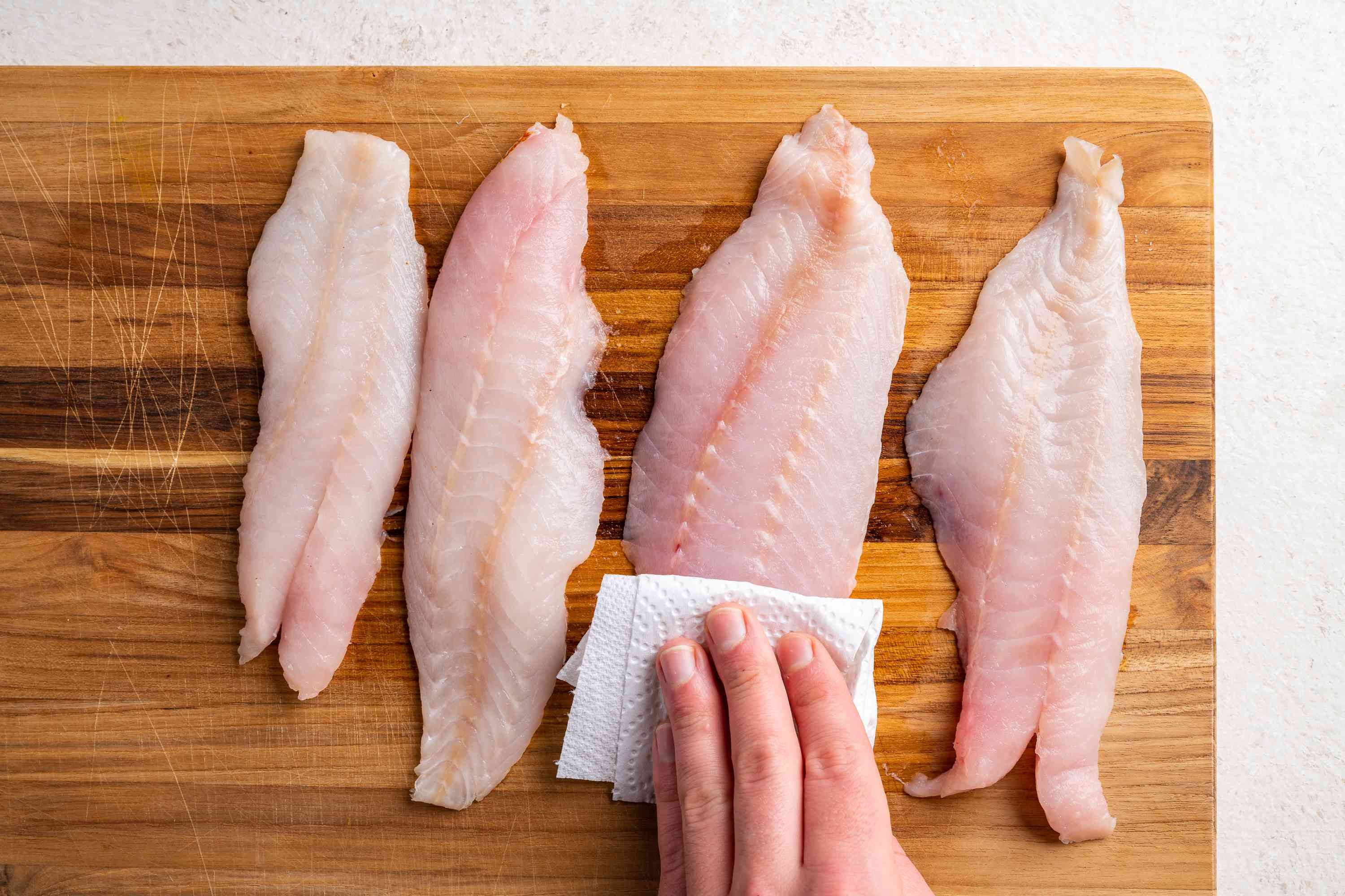 wash and dry the fish with a paper towel