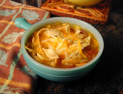 Chicken tortilla soup in bowl on table