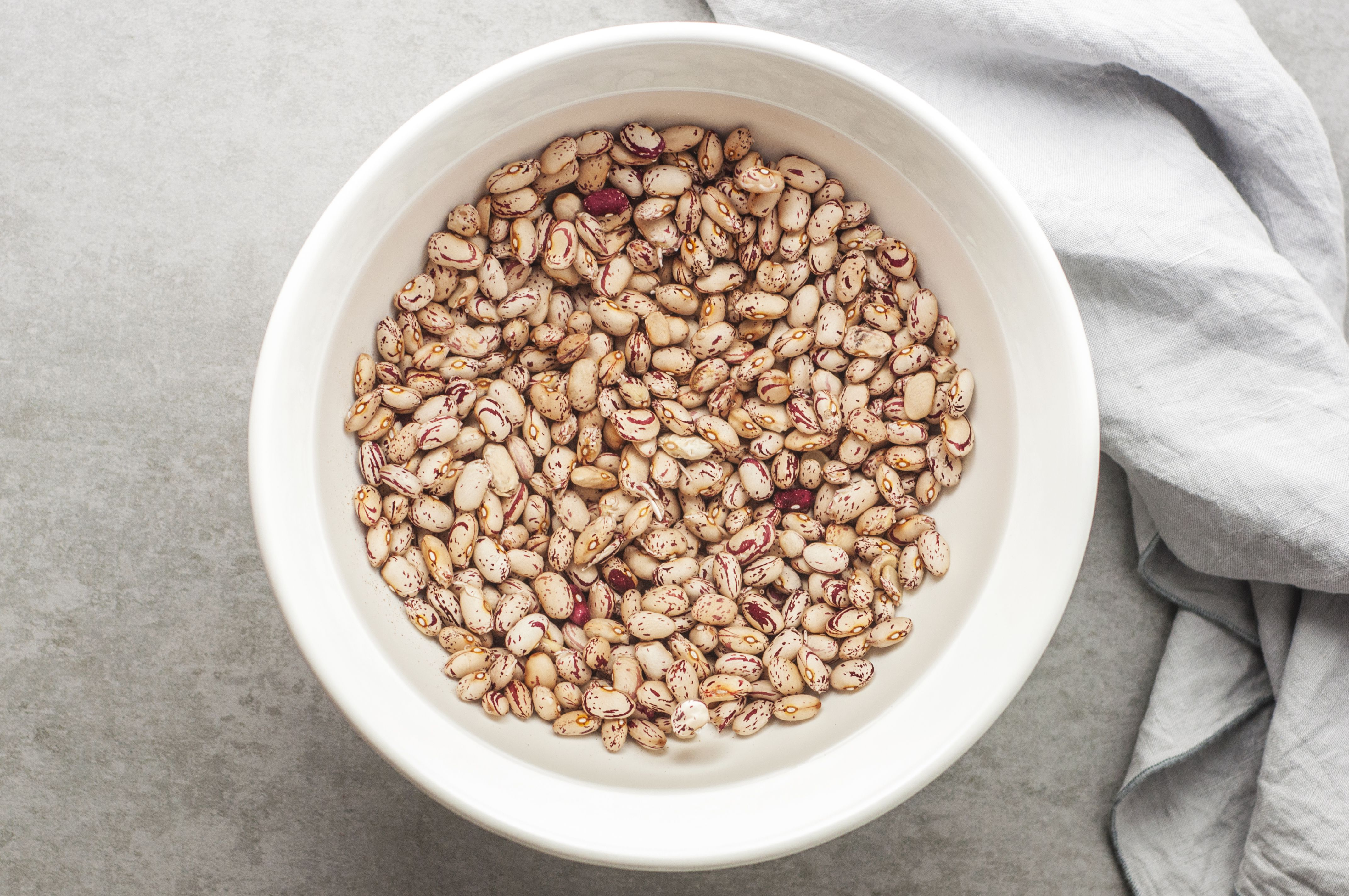 Beans in a bowl covered by water