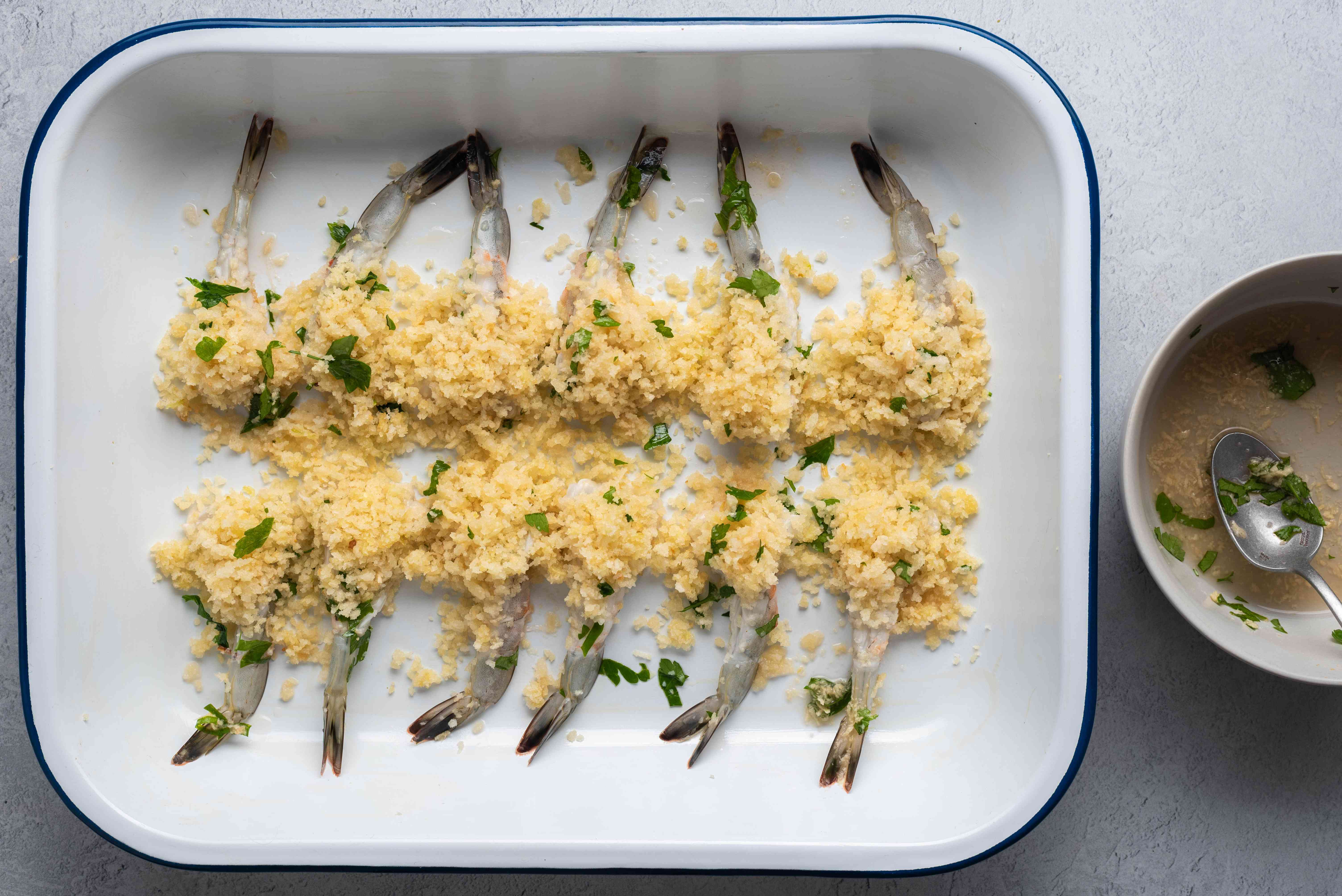 Arrange the stuffed shrimp in the prepared baking dish and drizzle the reserved marinade over the shrimp