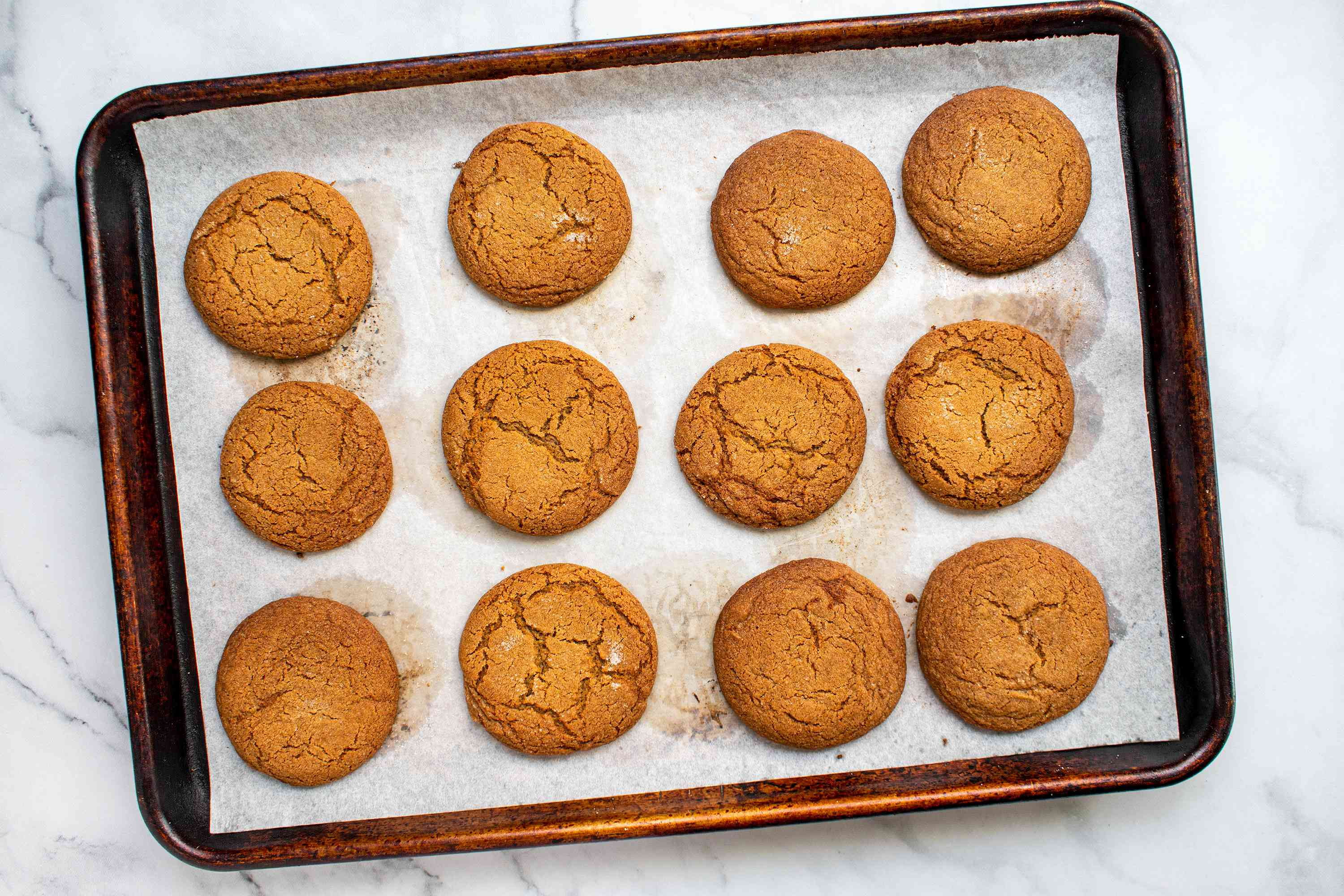 Chewy gingerbread cookies on a baking sheet