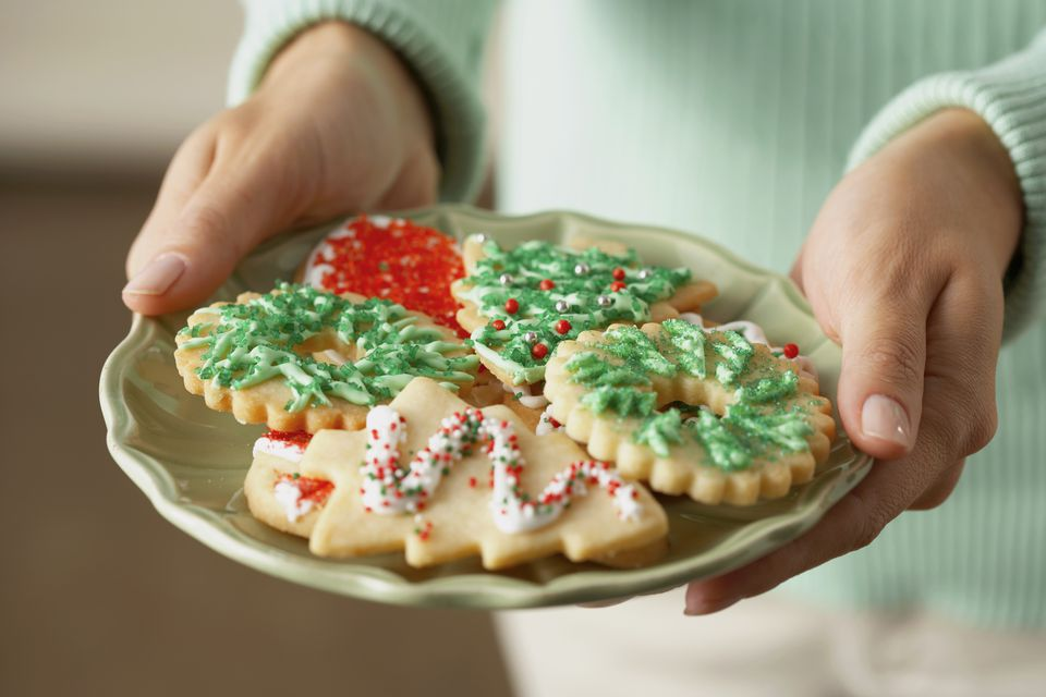woman holding plate of cookies