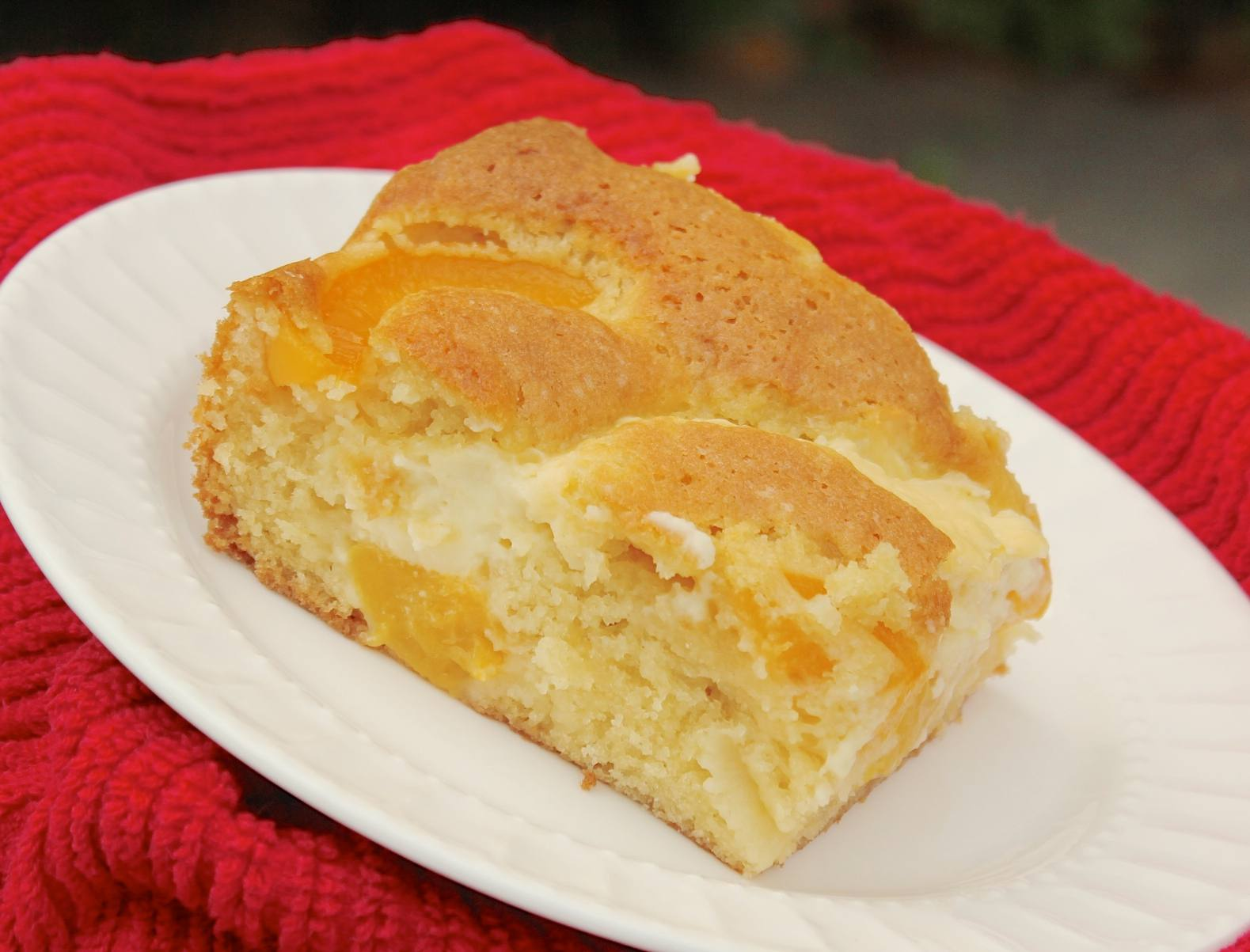 Peach pudding cake on a plate