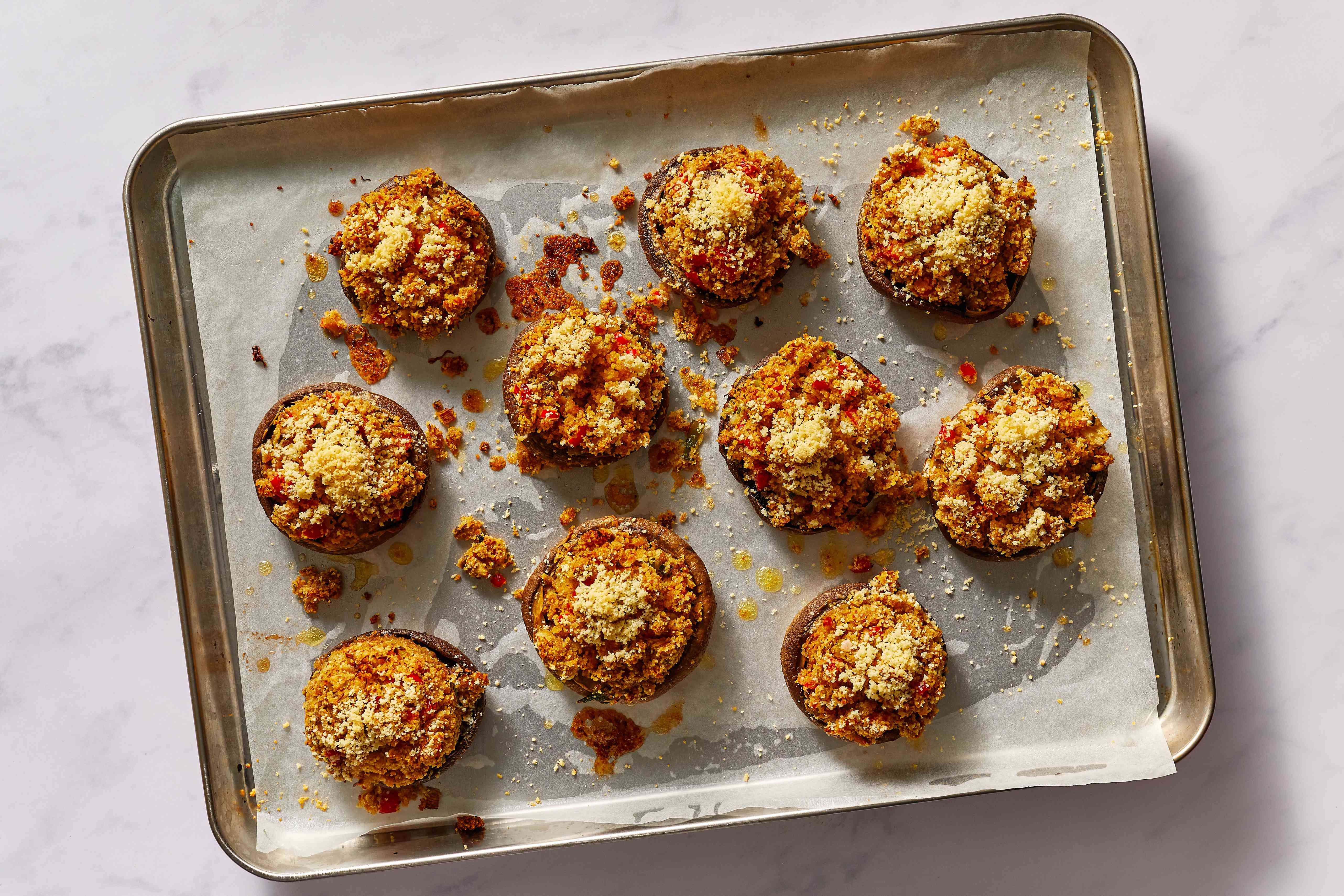 Crab-Stuffed Mushrooms With Parmesan Cheese on a baking sheet