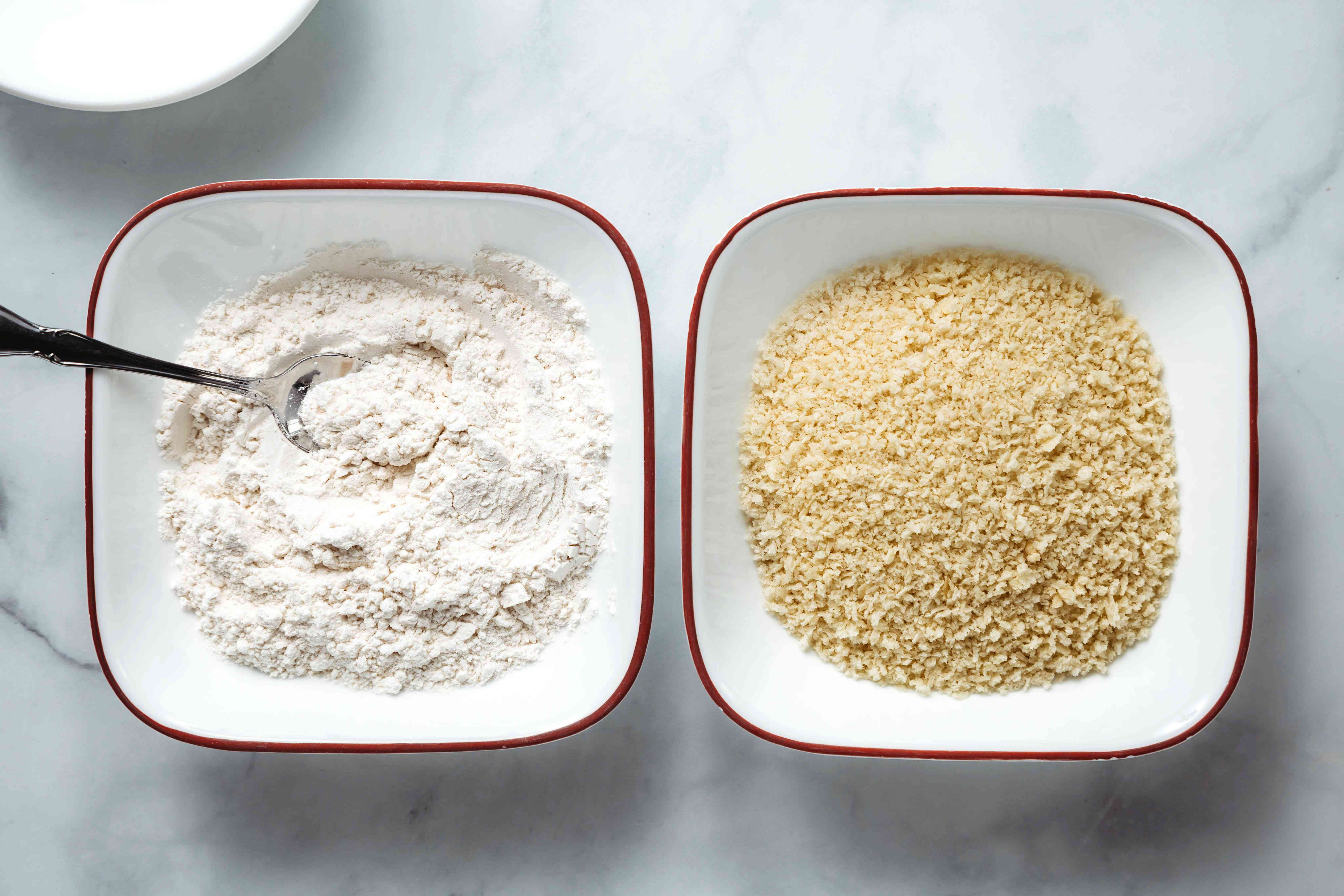 Two bowls: one with flour and salt and the other with breadcrumbs