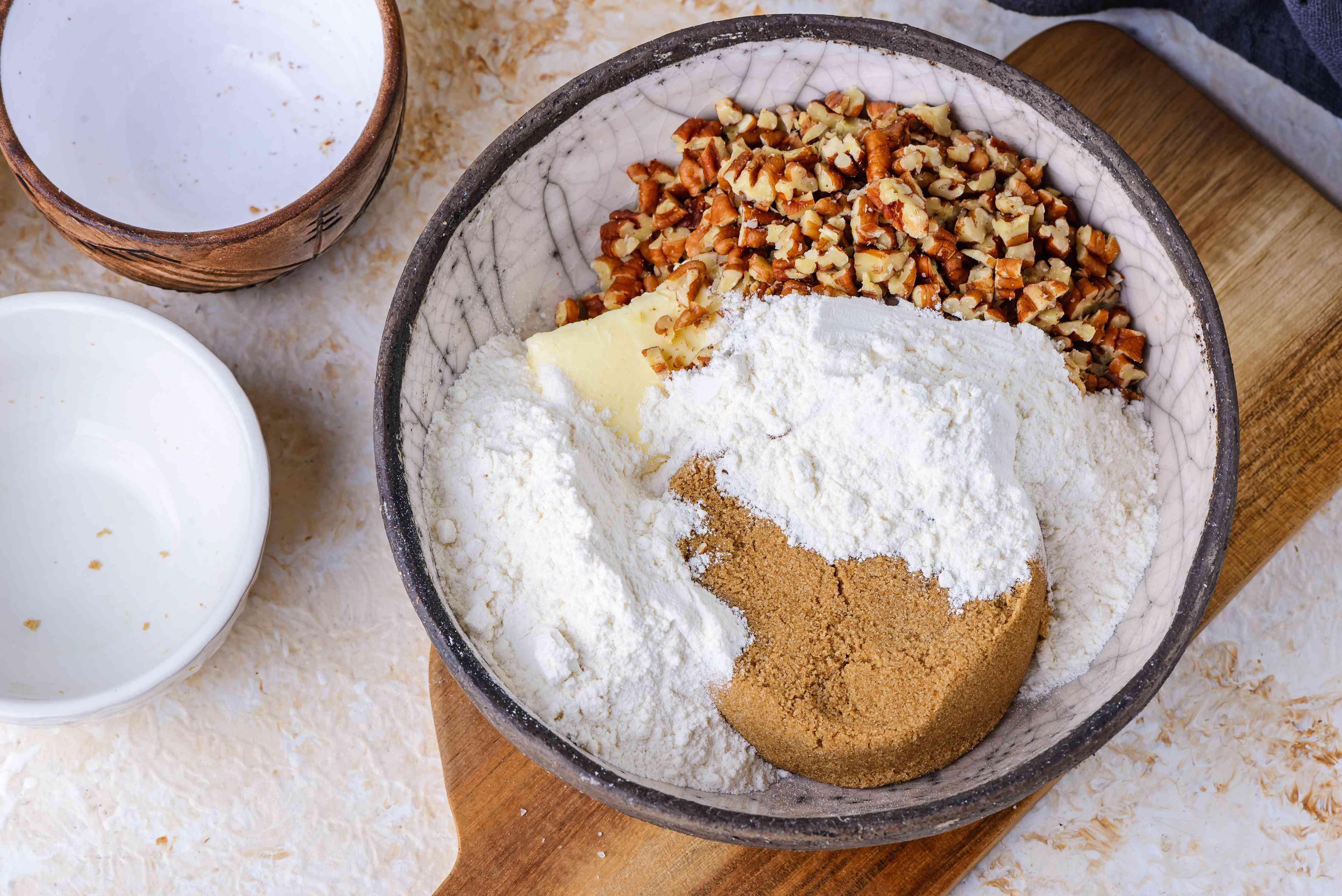 Combine brown sugar, butter, pecans