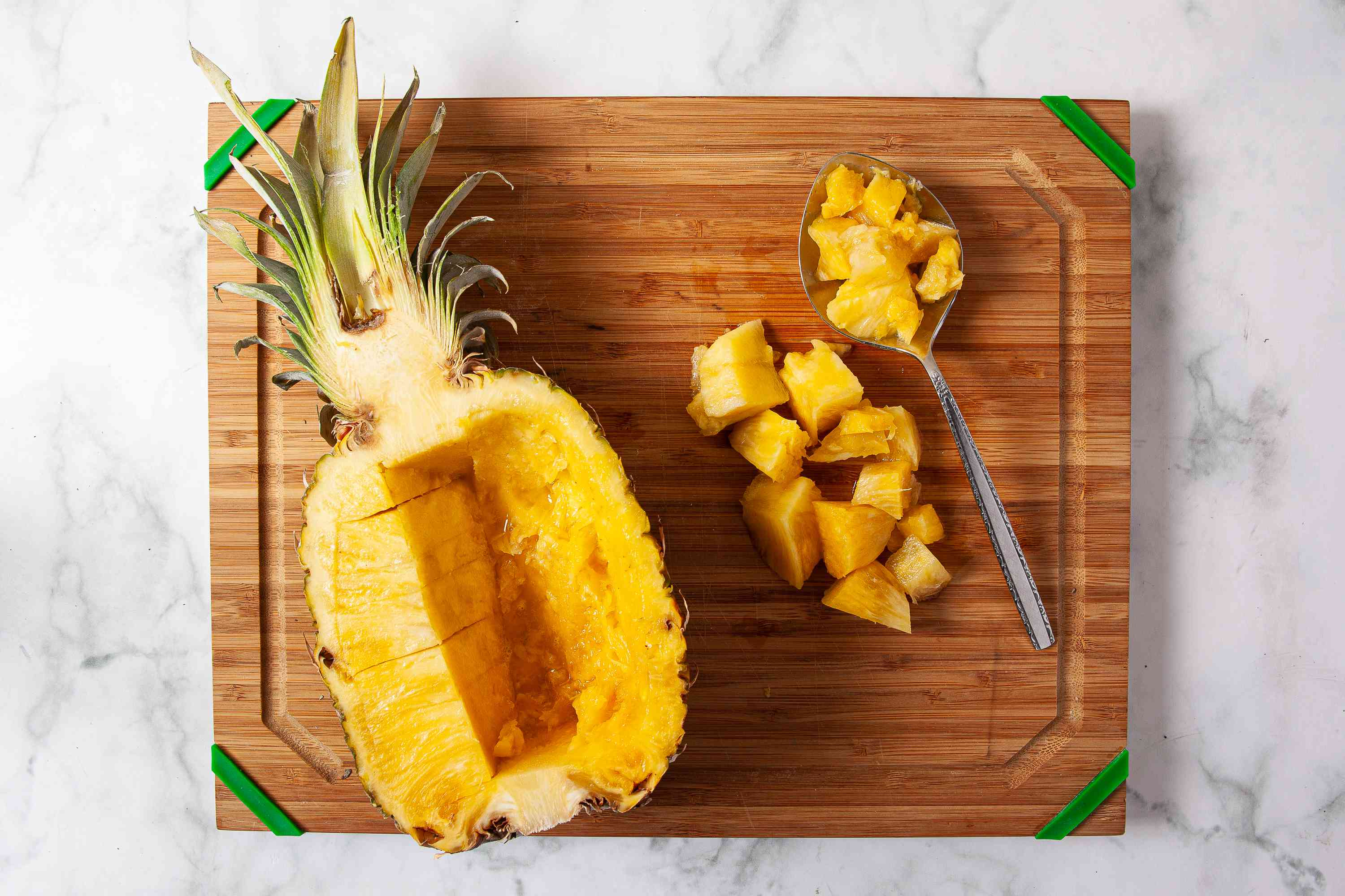 Score the pineapple by slicing into chunks