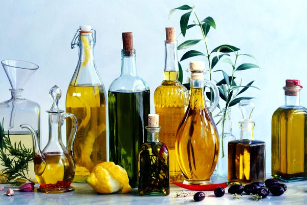 A variety of flavored olive oils in various shaped bottles