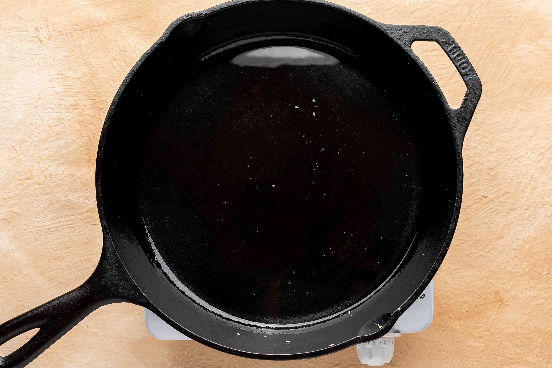 Heat lard in saucepan for mole