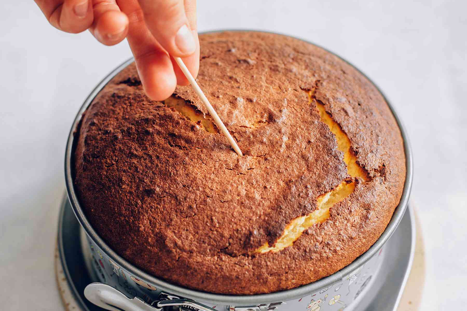Testing almond-lemon cake with a toothpick
