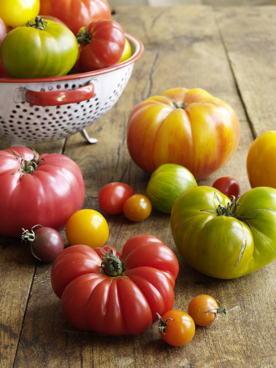 Variety of heirloom tomatoes on wood surface