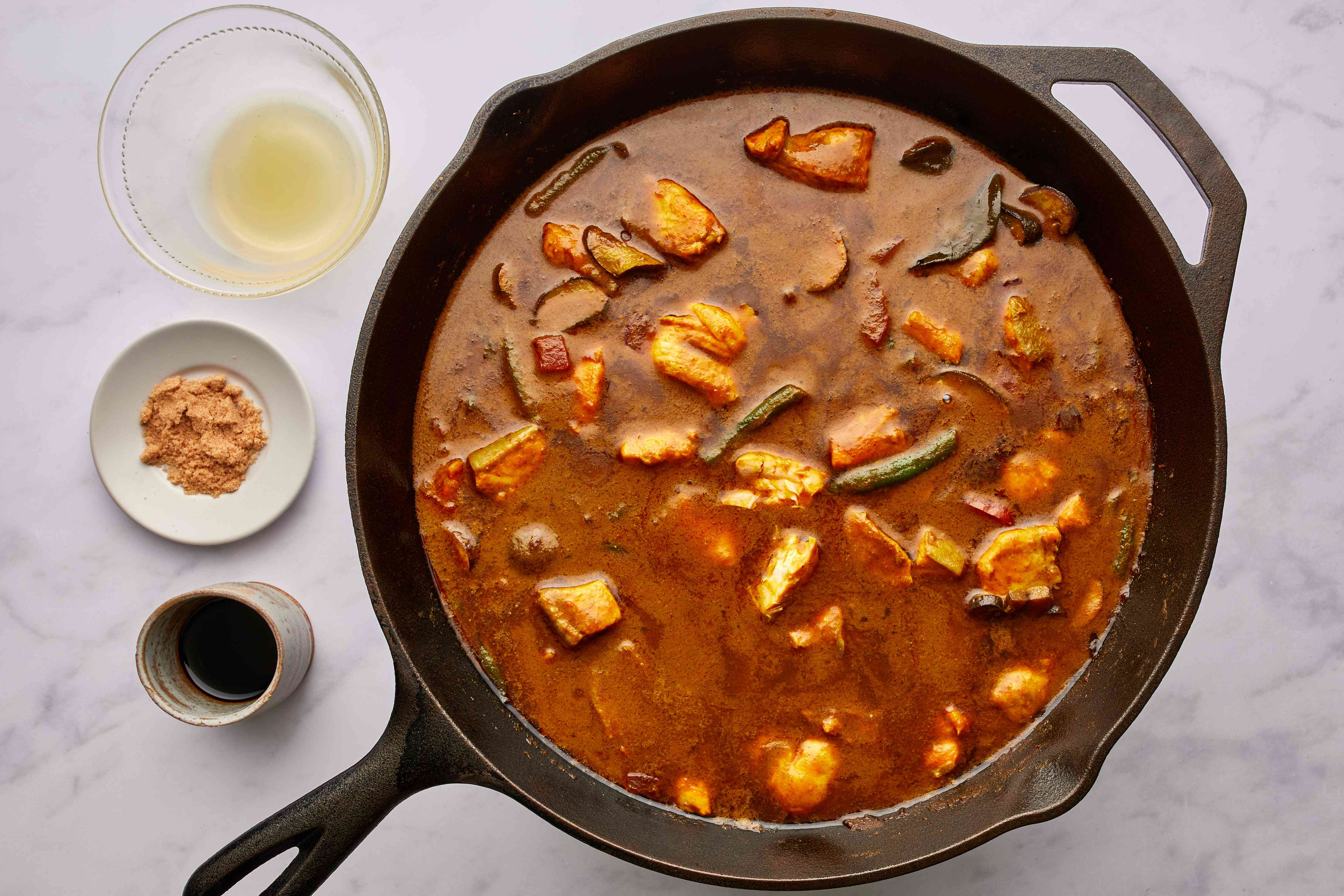 add fish sauce to the curry in the pan