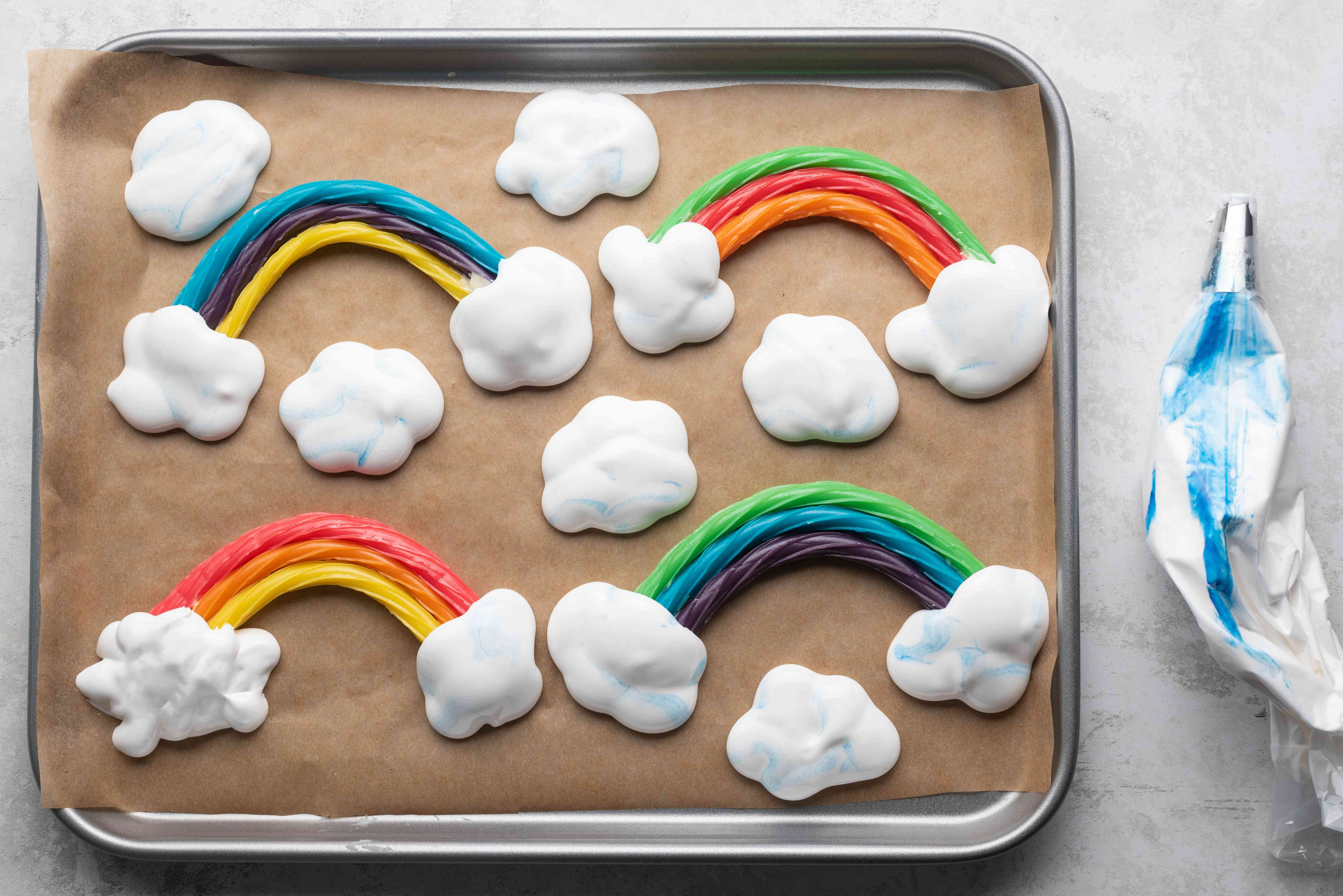 marshmallow clouds piped on the baking sheet along side the licorice rainbows