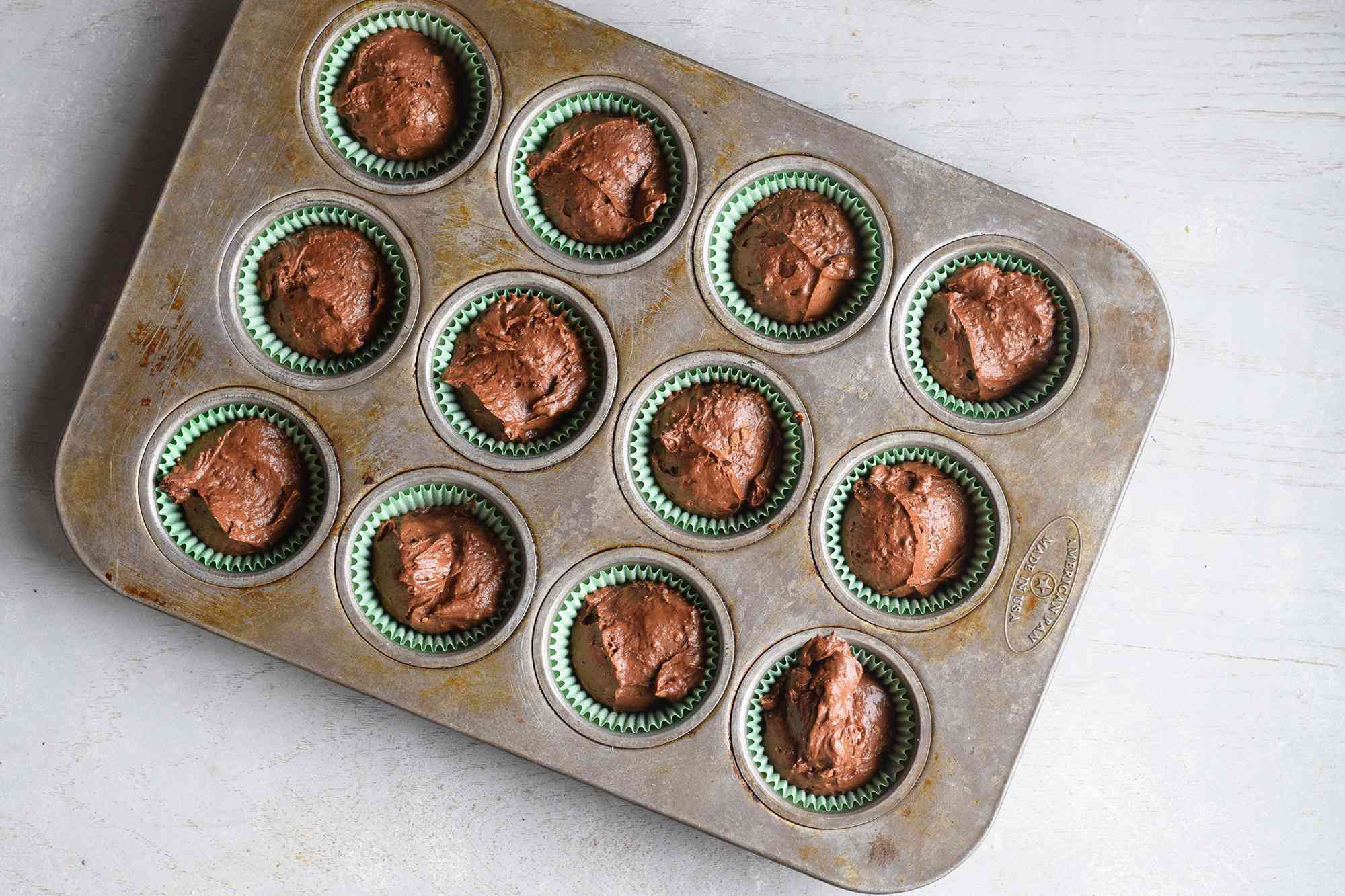 Chocolate cupcake batter in liners