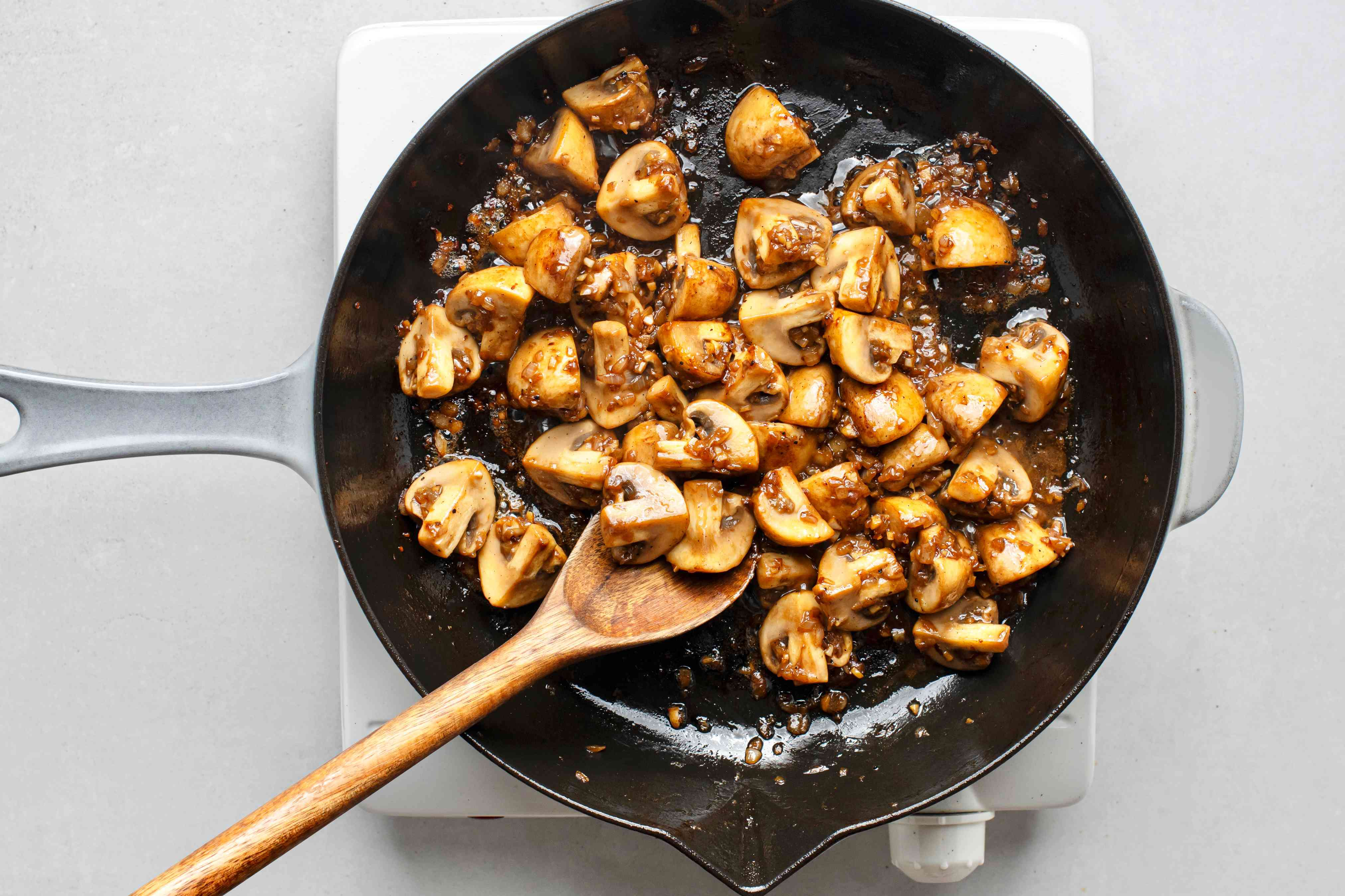 Saute until mushrooms have released their liquid, with the garlic mixture