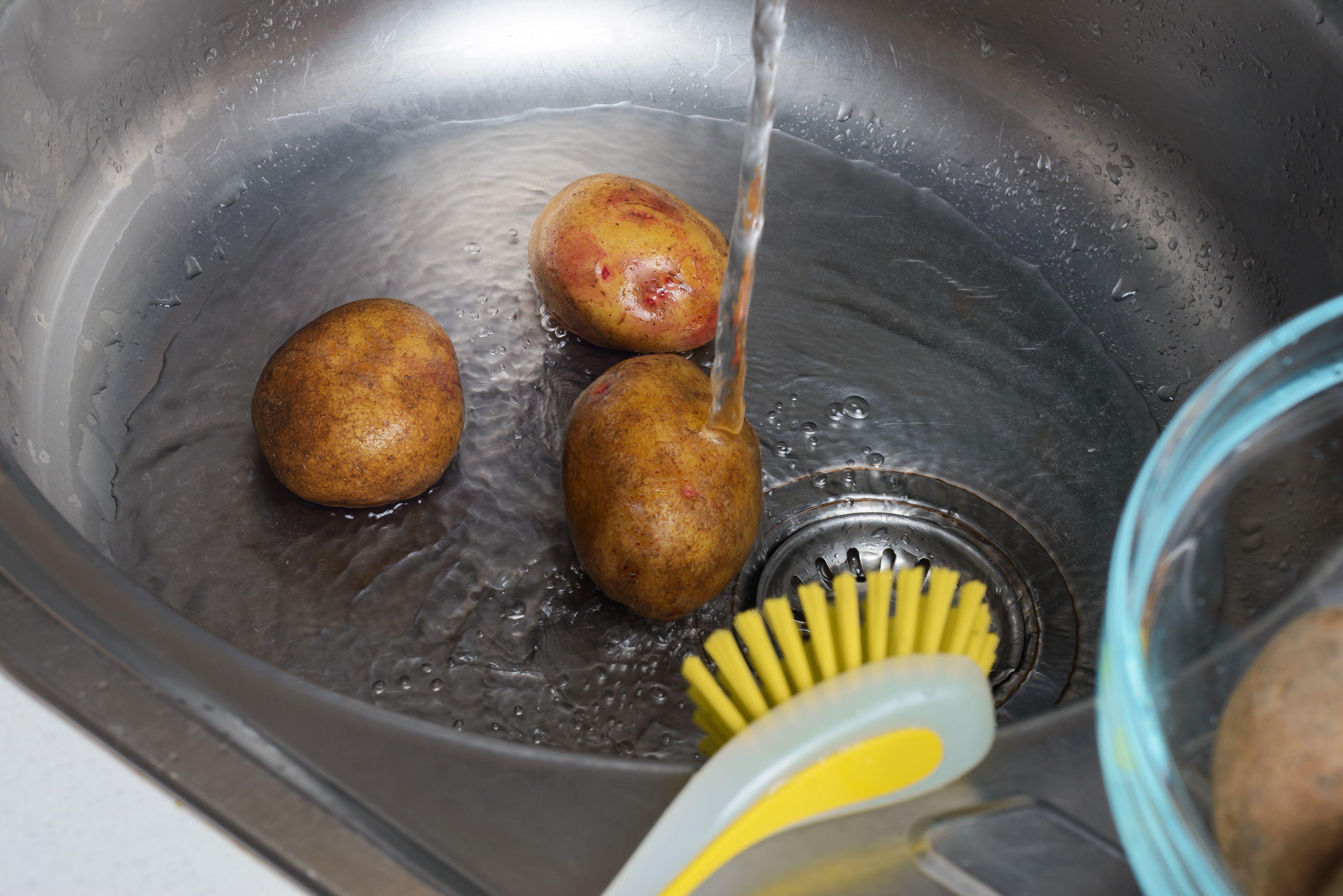 Scrub potatoes
