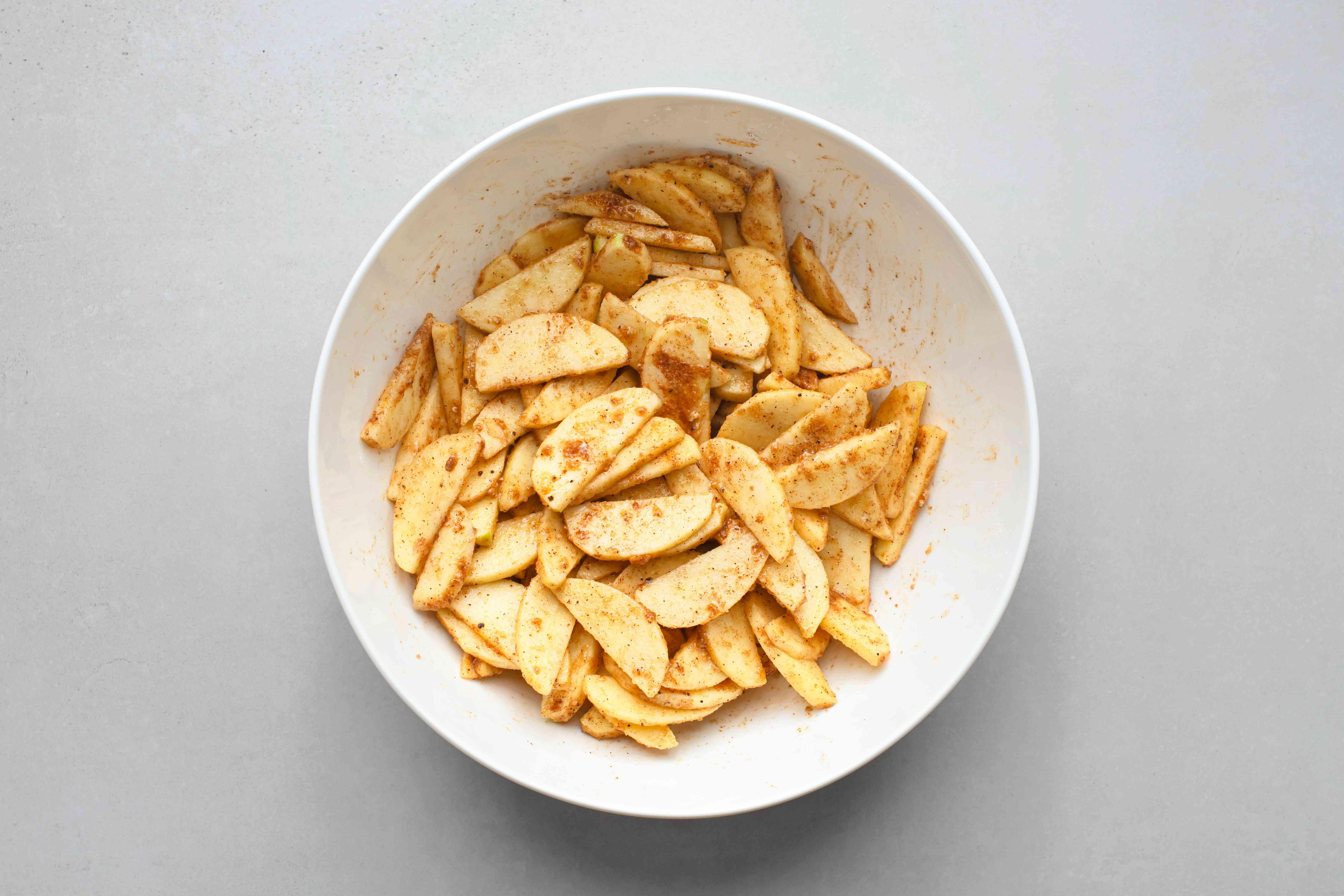 Sprinkle the apples with the brown sugar, sugar, flour, cinnamon, nutmeg, salt, cloves, and allspice