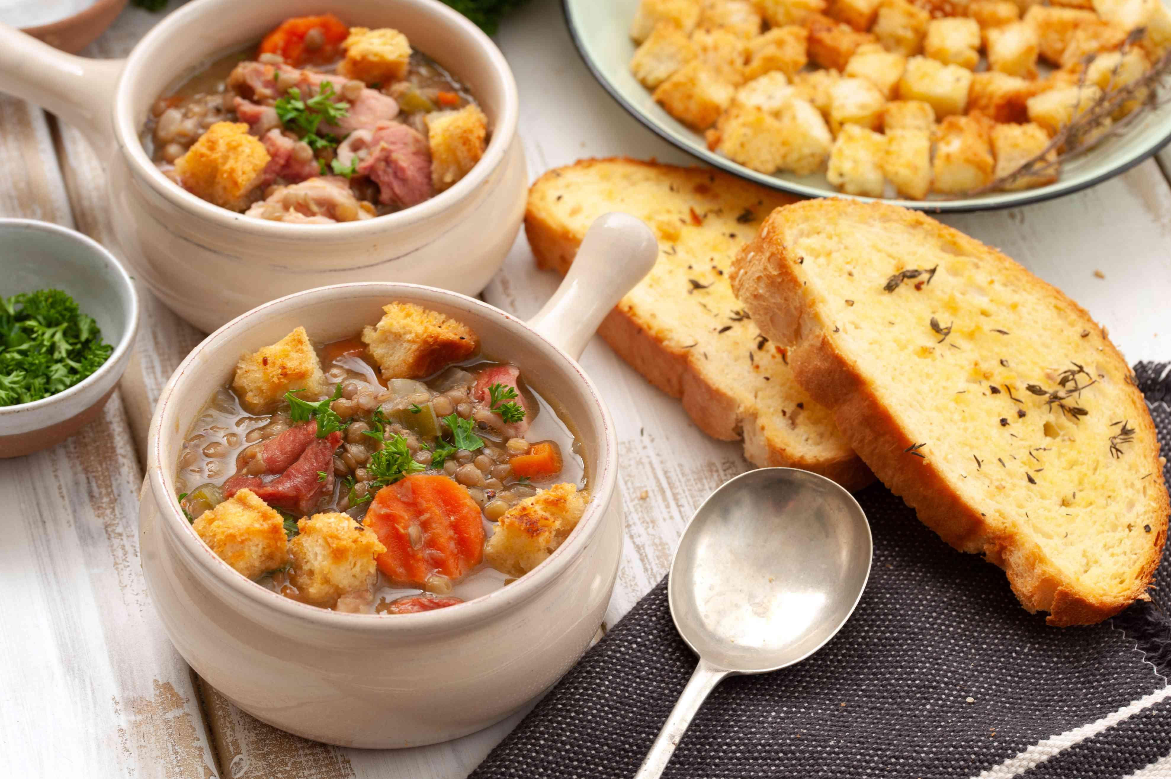 Bowls of lentil soup with parsley garnish